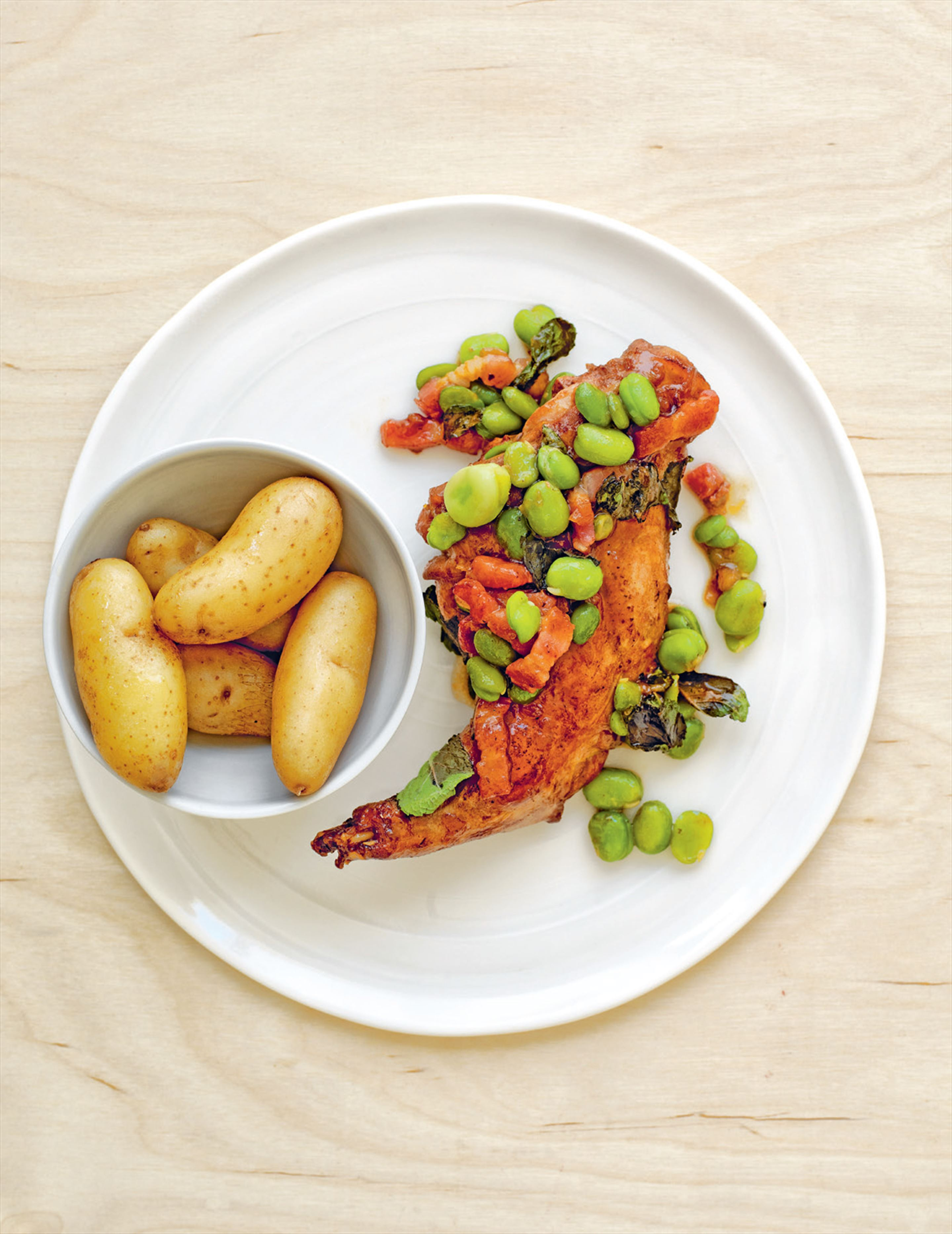 Braised rabbit with broad beans, bacon & mint