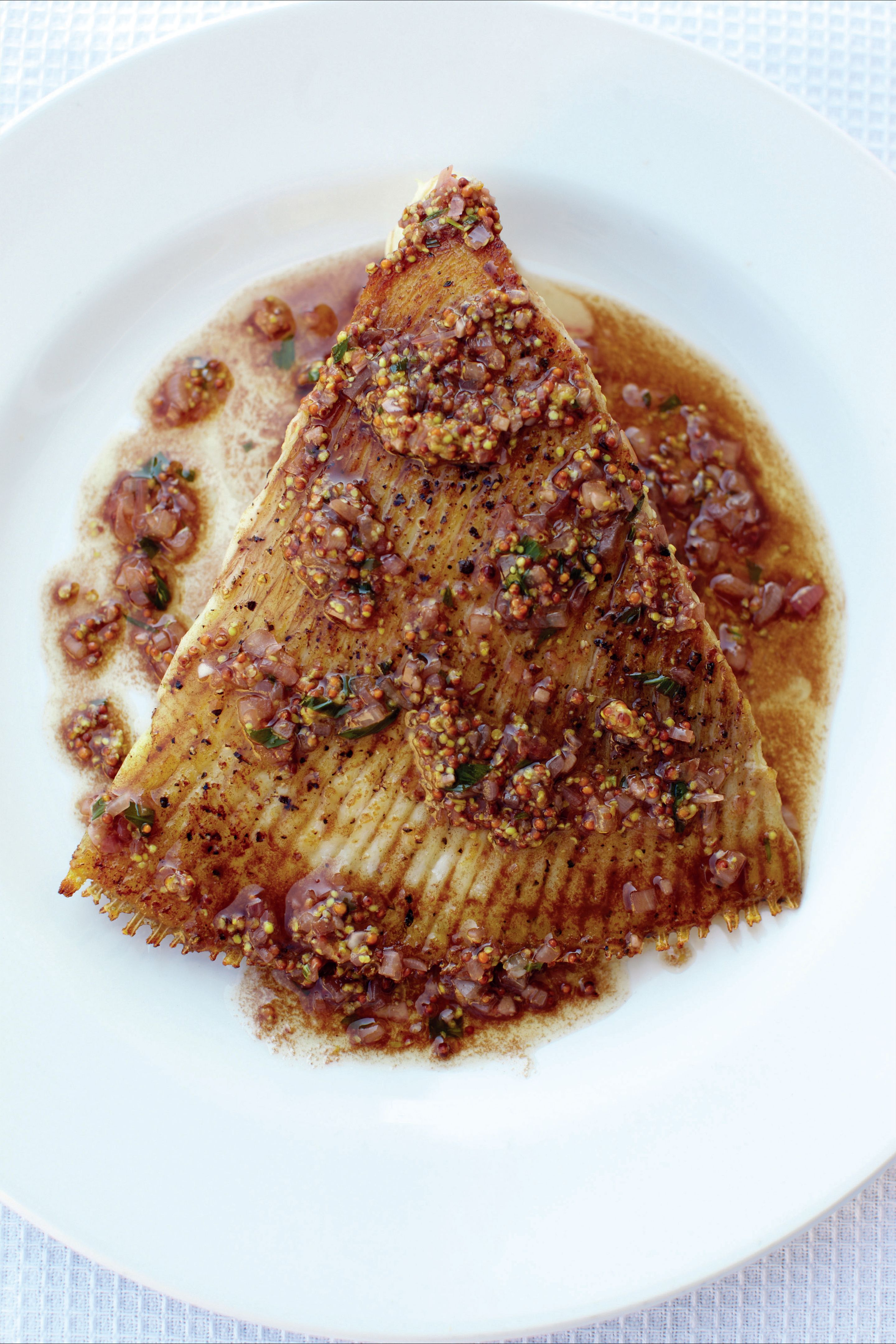 Peppered ray with tarragon, lemon and mustard brown butter