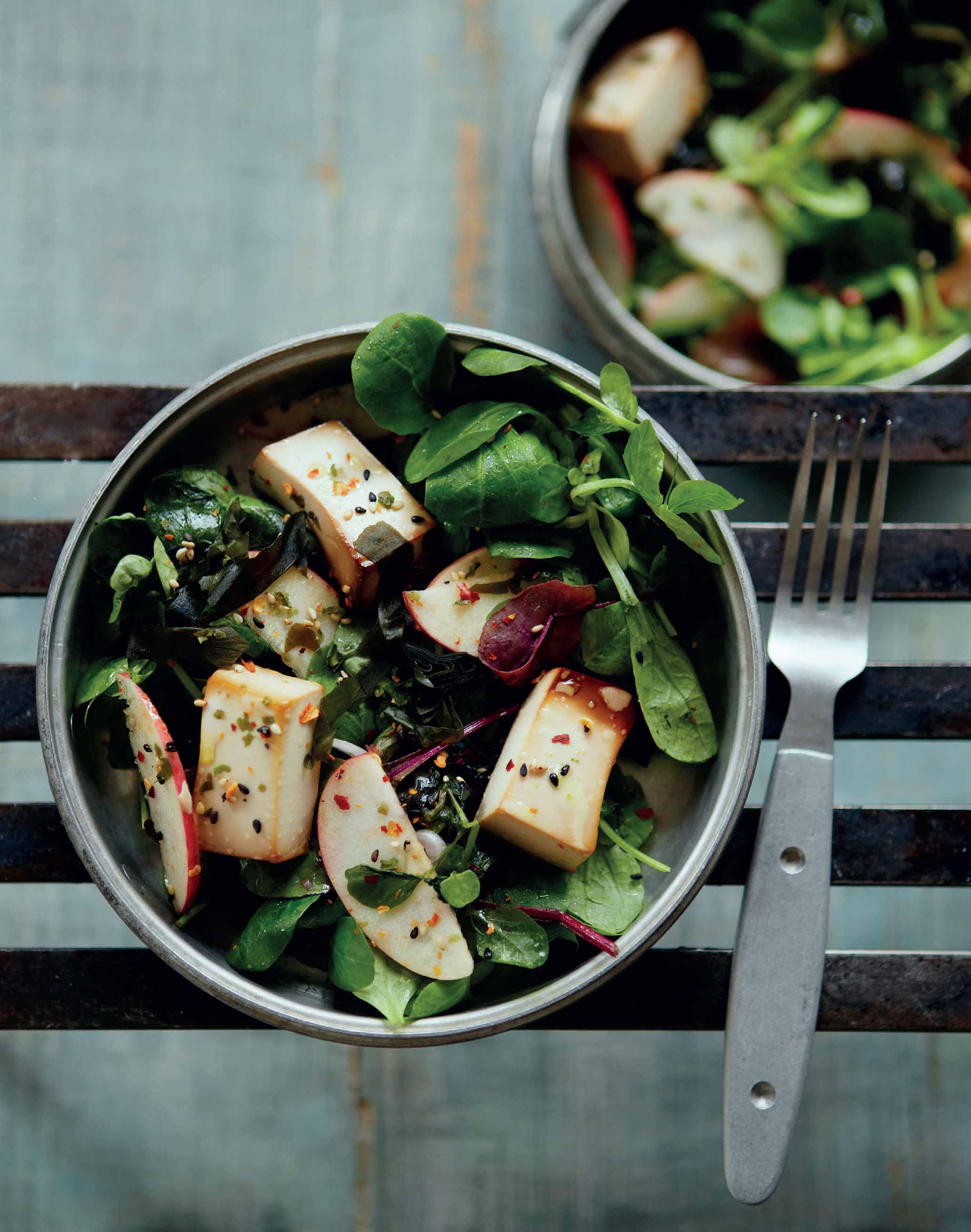 Baked tofu and apple on mixed greens and wakame