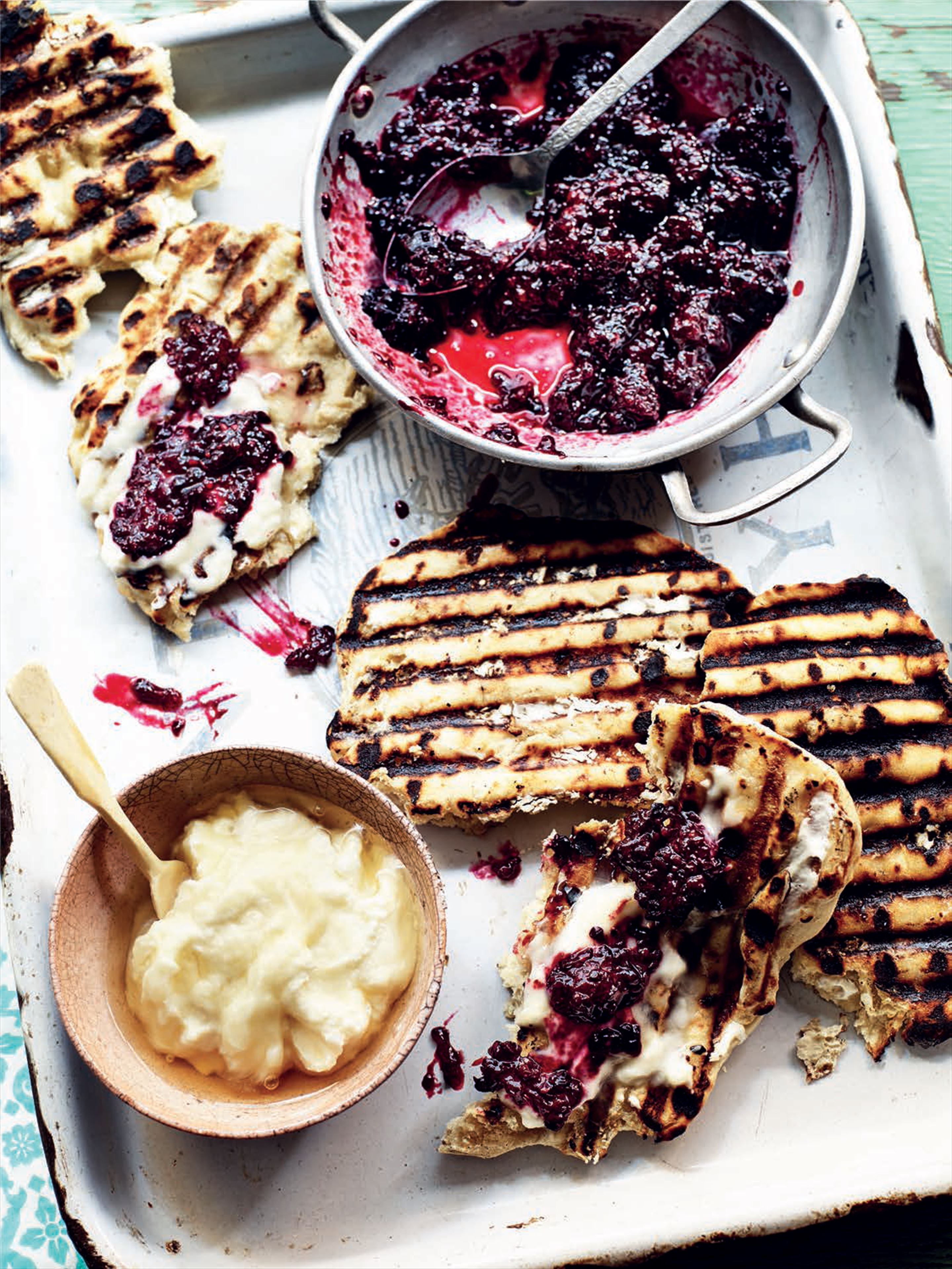 Slow-cooked blackberries with Turkish pide and creamed sheep's cheese