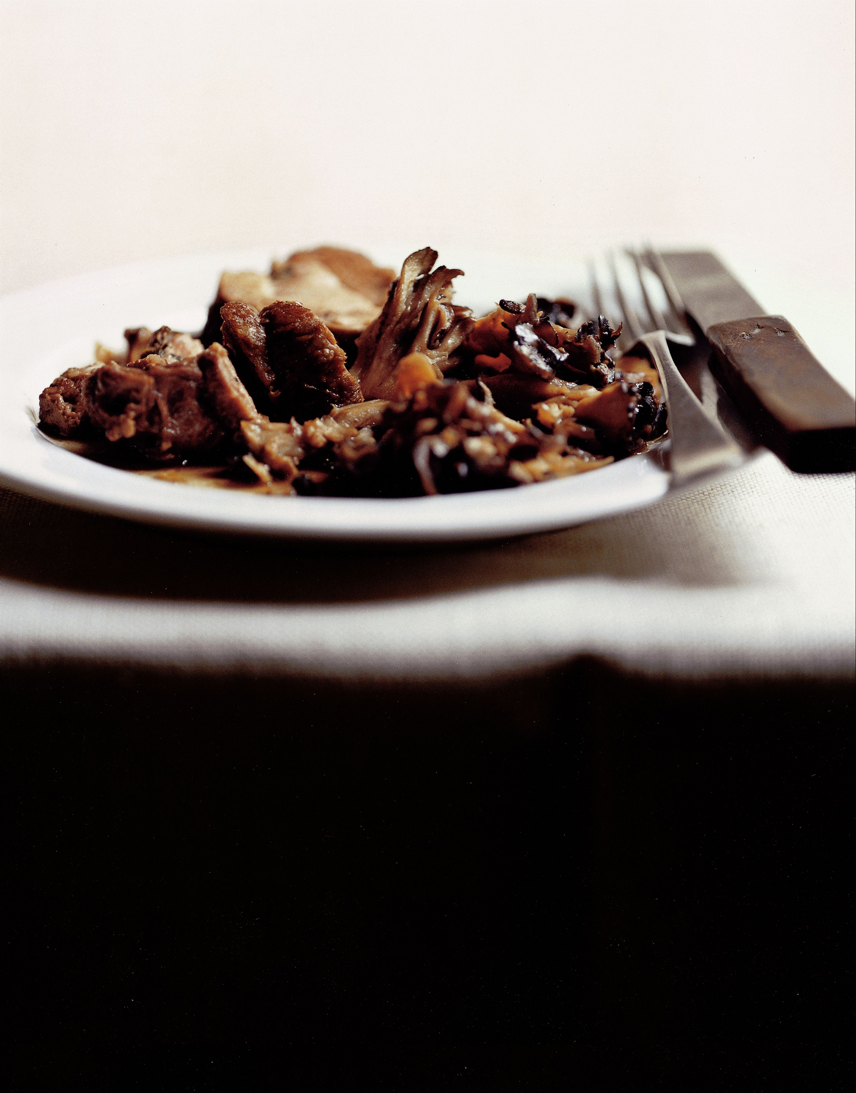 Shoulder of lamb with mushrooms