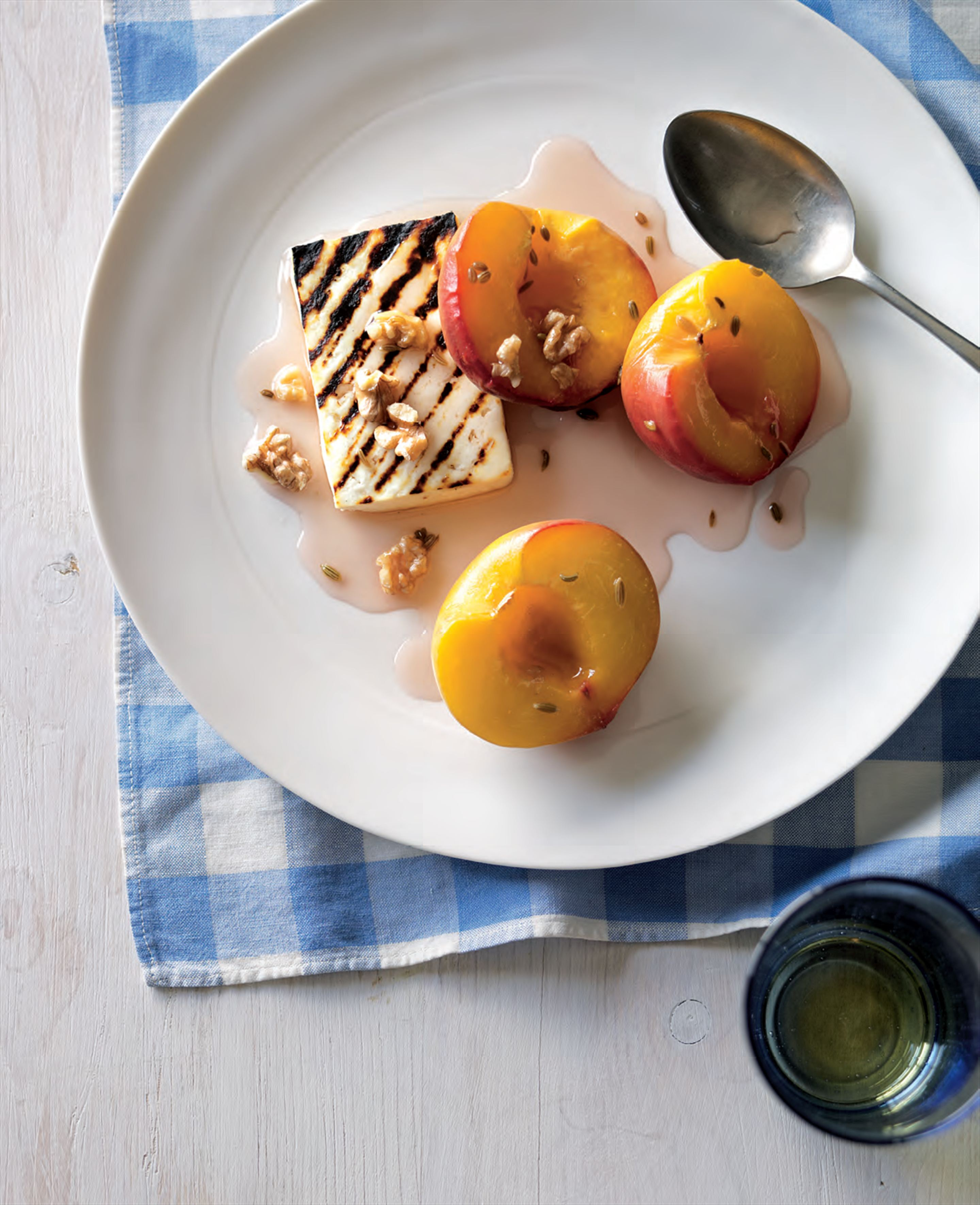 Chargrilled manouri served with honey-baked peaches