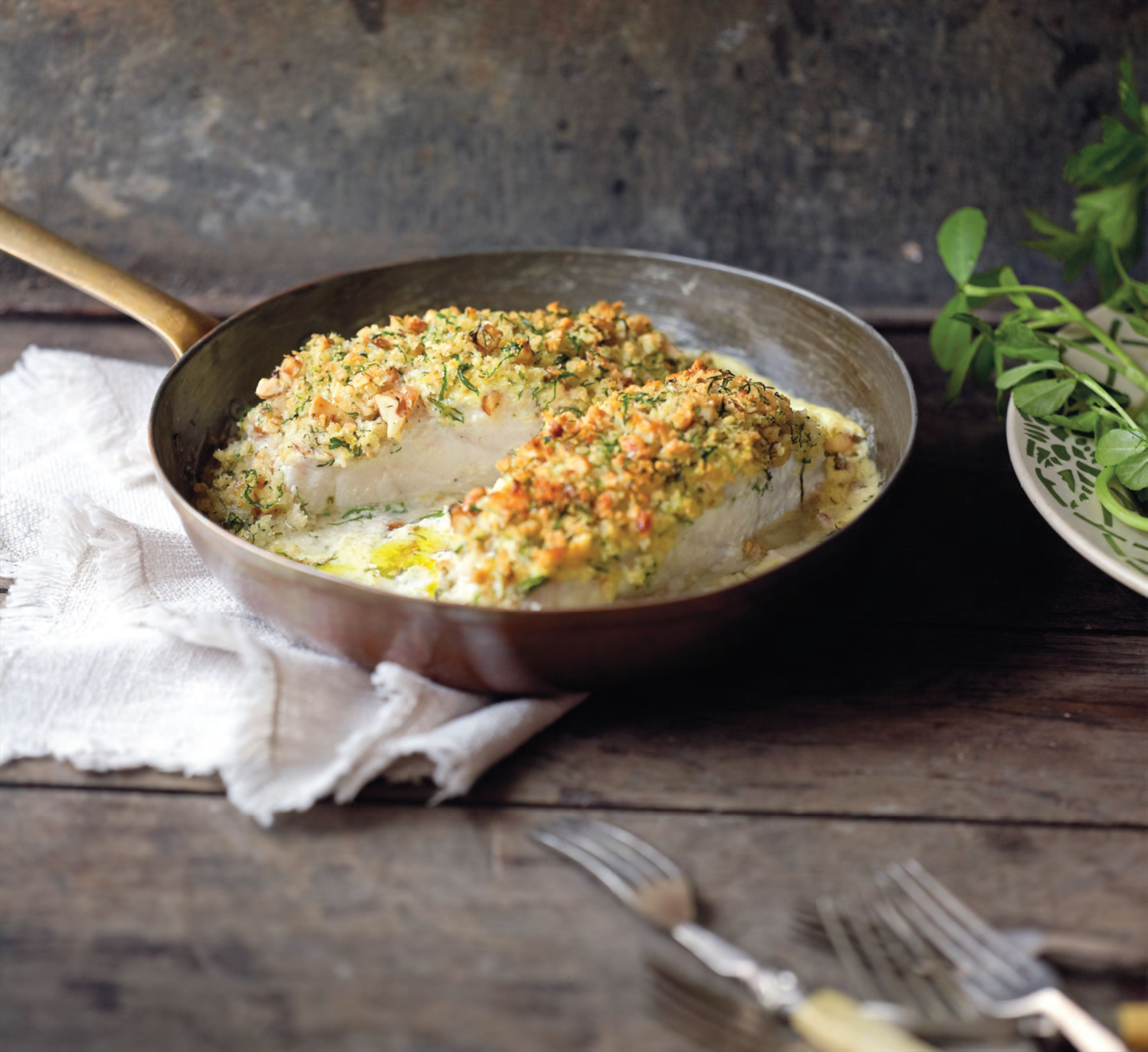 Yoghurt baked fish with walnut–herb crumbs