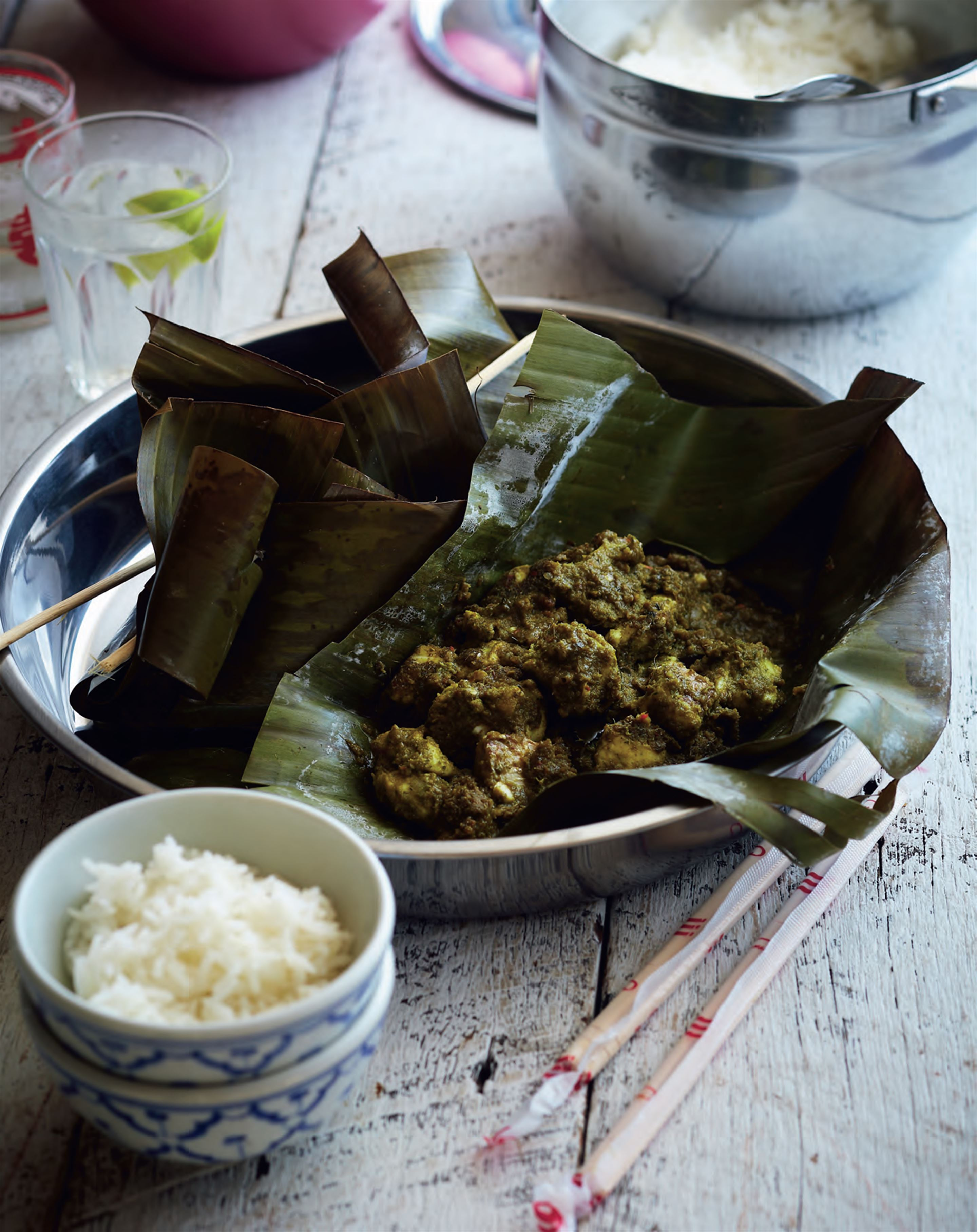 Steamed fish in banana leaves