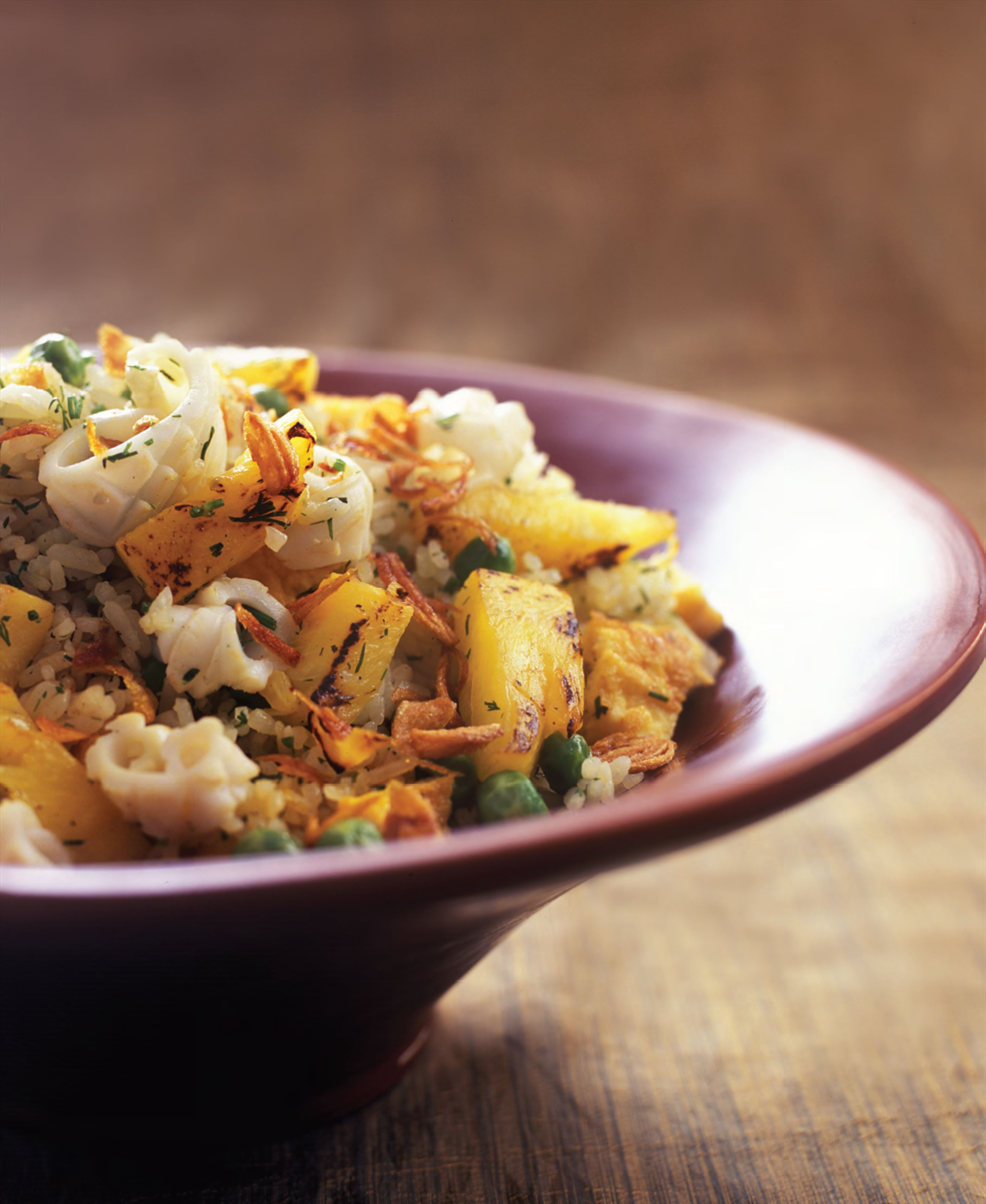 Fried rice with cuttlefish, pineapple and dill