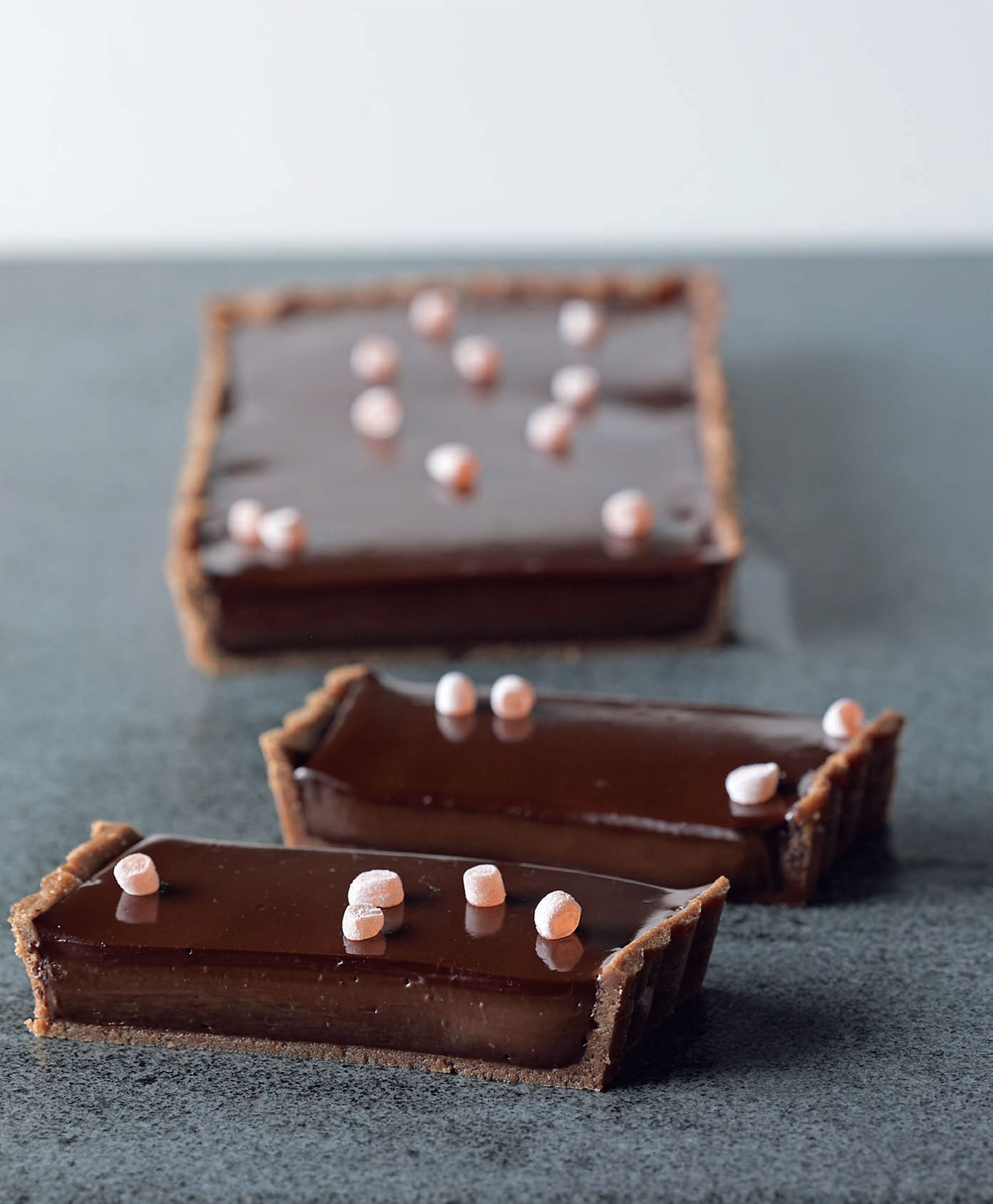 Rich chocolate and cardamom tart with Turkish delight jewels
