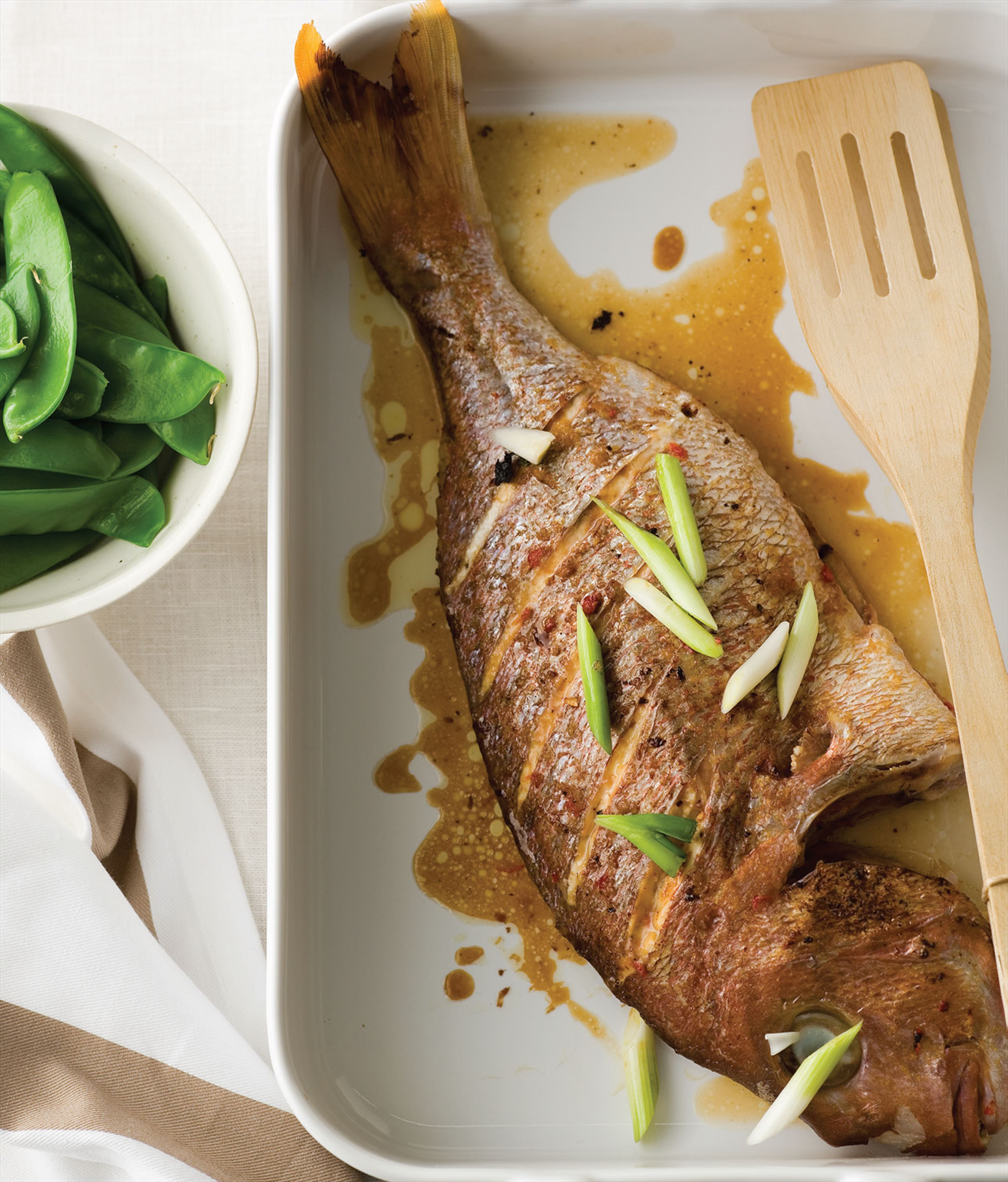 Baked snapper Asian-style with snow peas