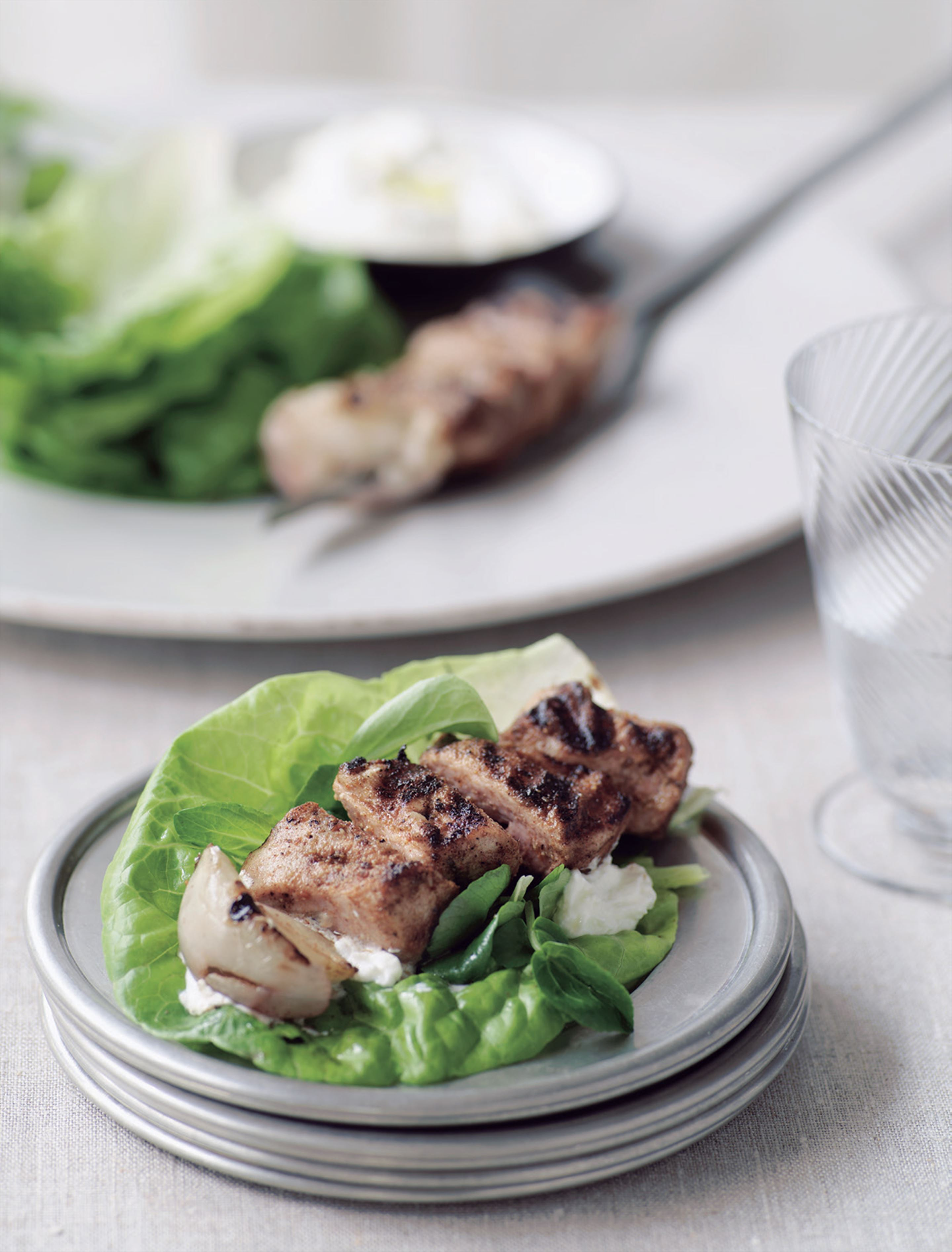 Rabbit kebabs in lettuce leaves