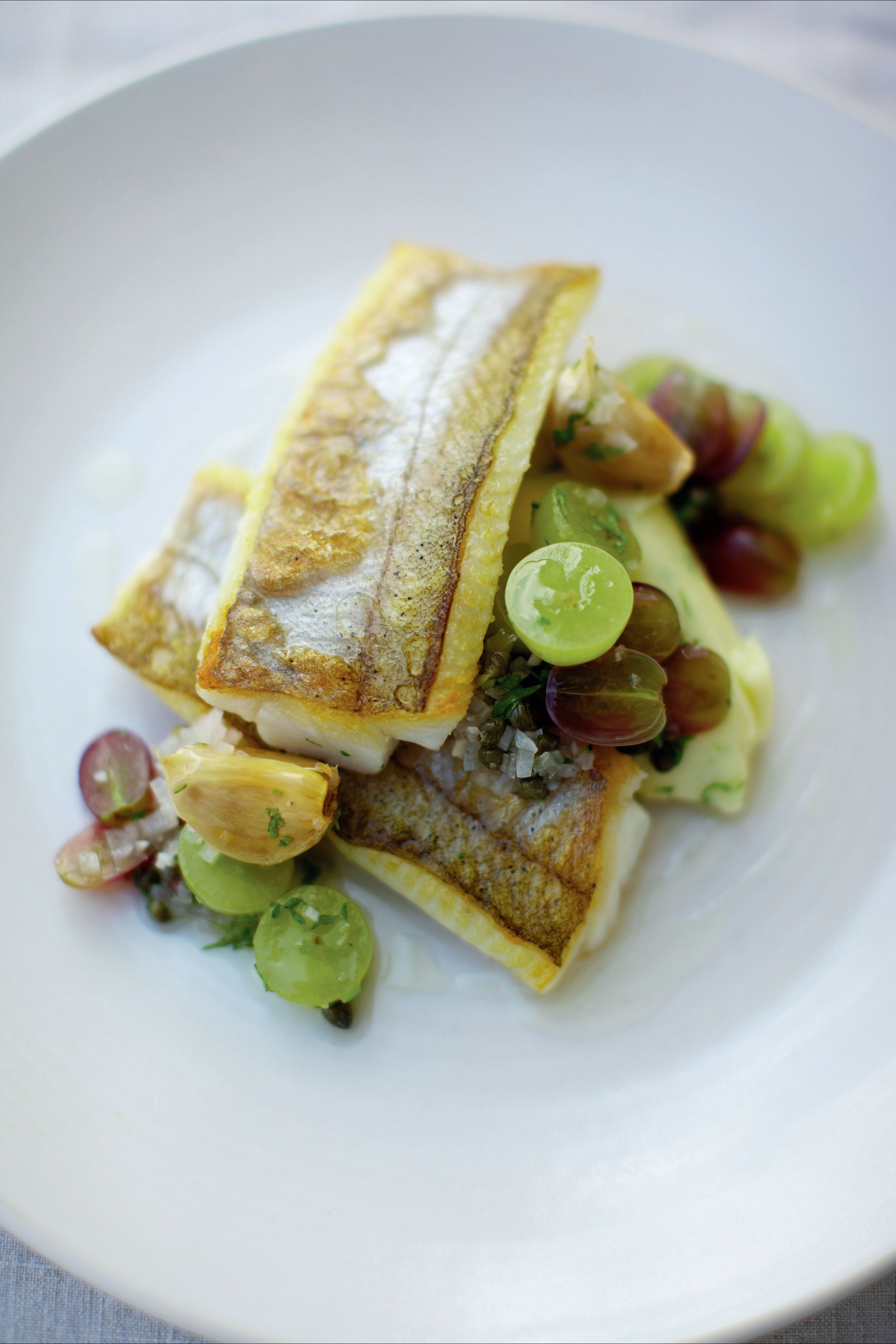 Whiting with grape dressing and roast garlic and potato purée
