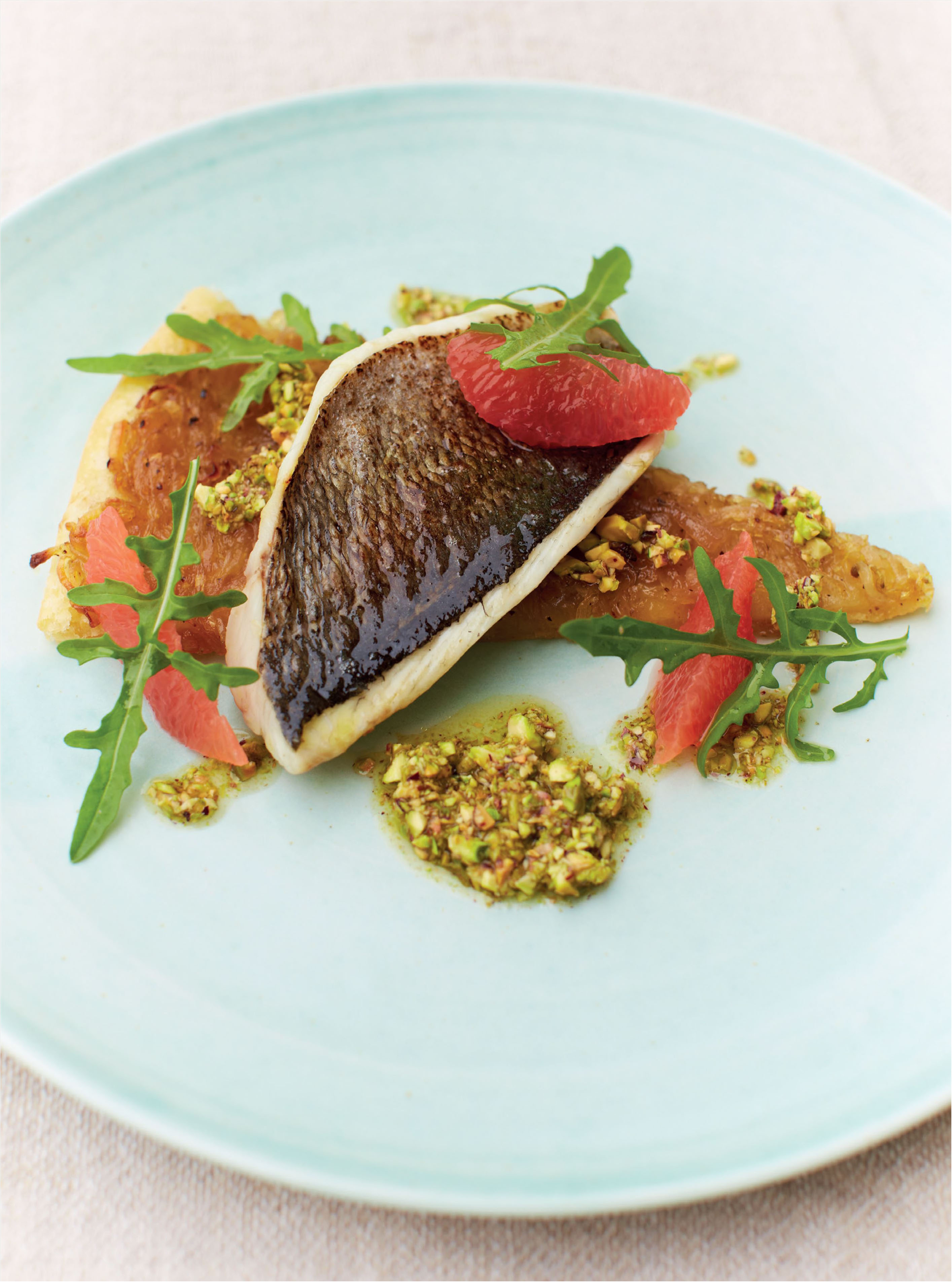 Bream with chicory tart, pink grapefruit and pistachio dressing