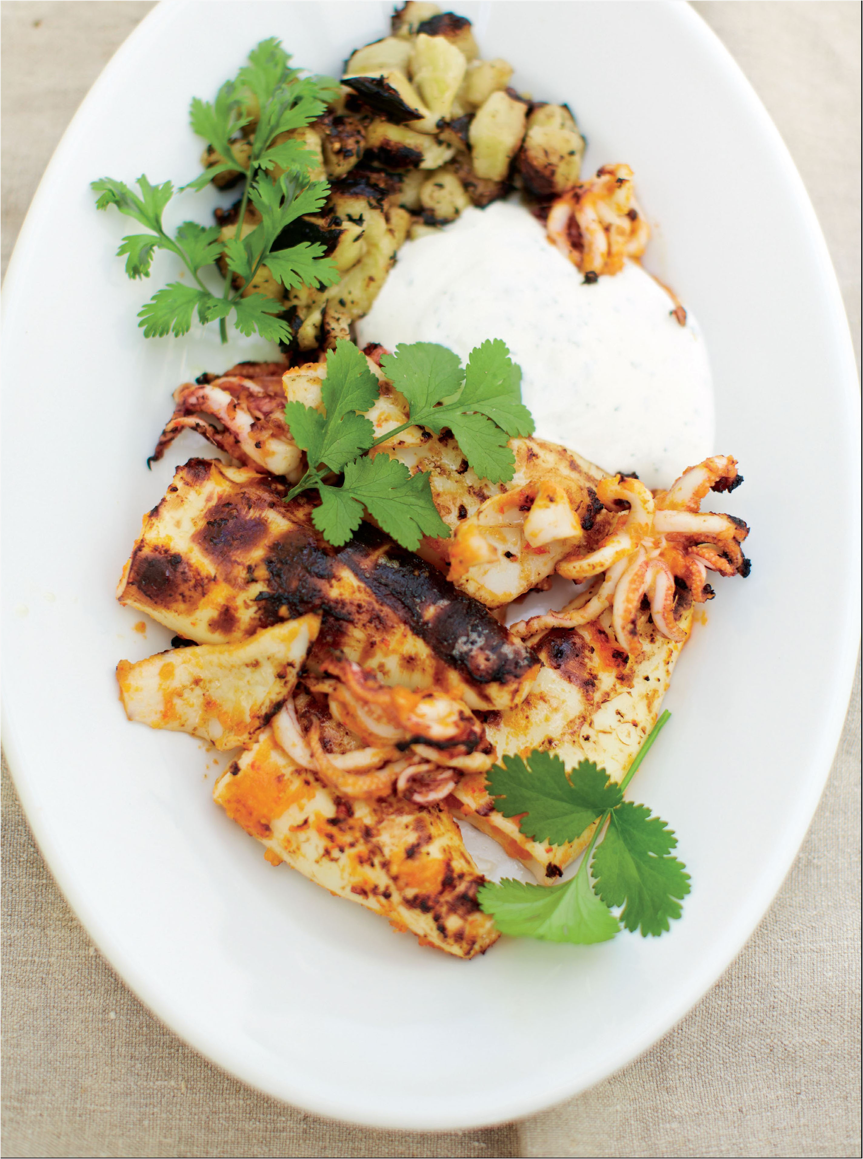 Barbecued chilli squid and aubergine with ginger and coriander yoghurt