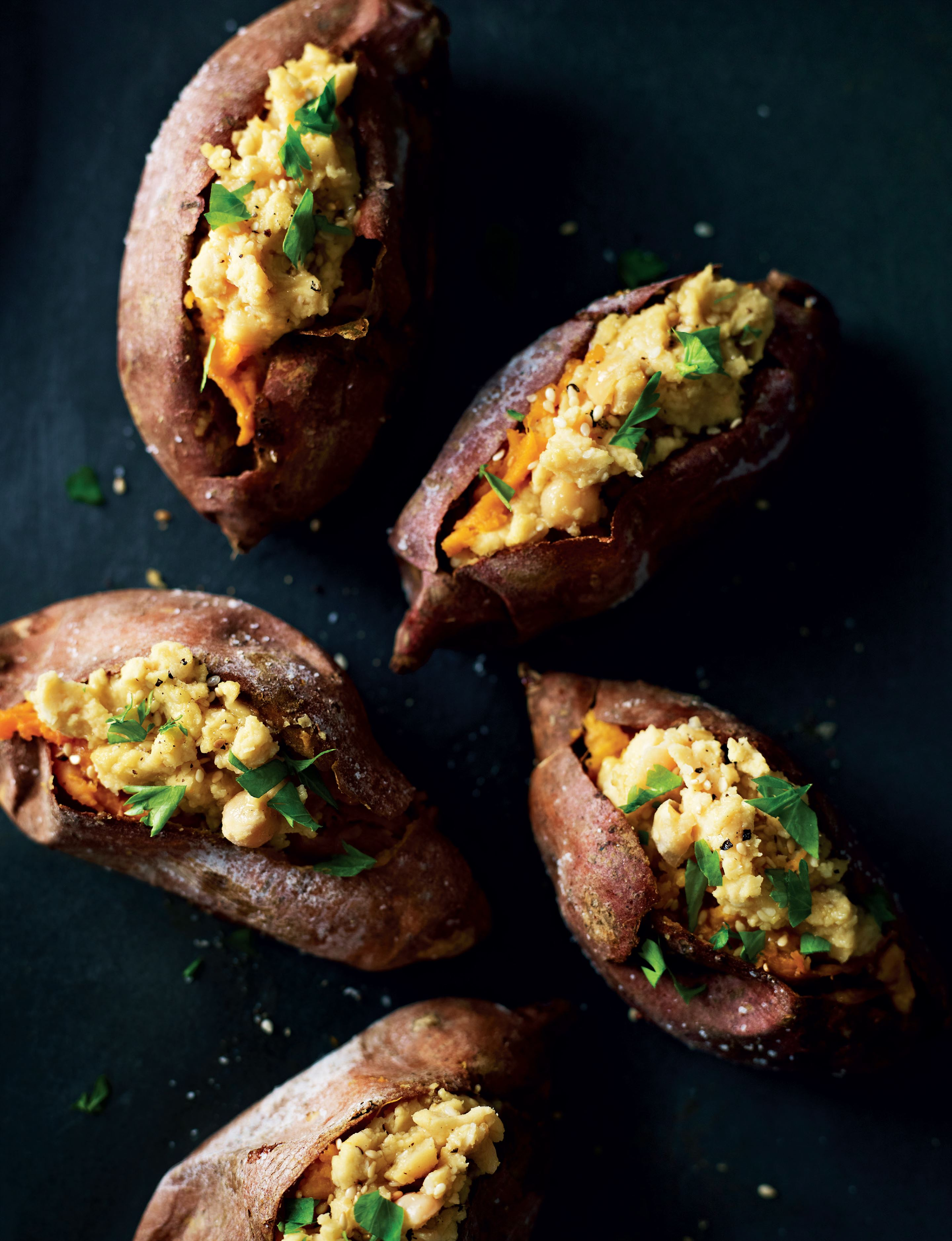 Baked sweet potatoes with omega houmous