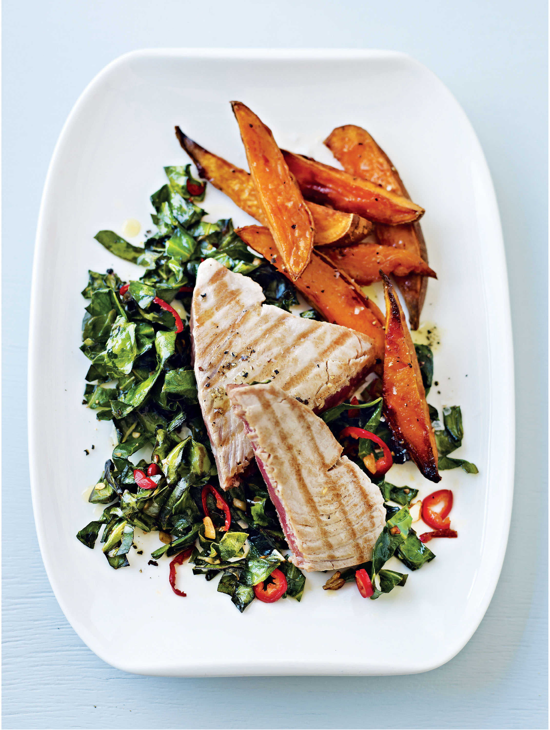 Tuna steaks with sweet potato wedges and spring greens