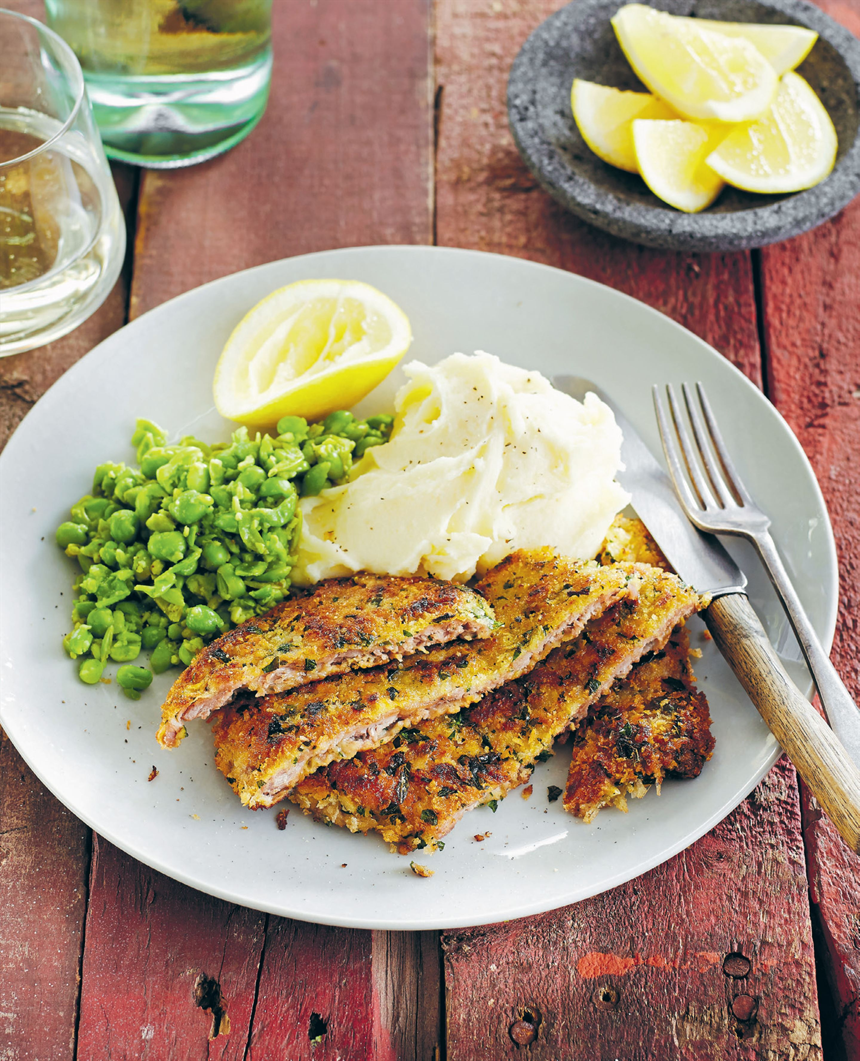 Veal schnitzel with mashed potato and smashed peas