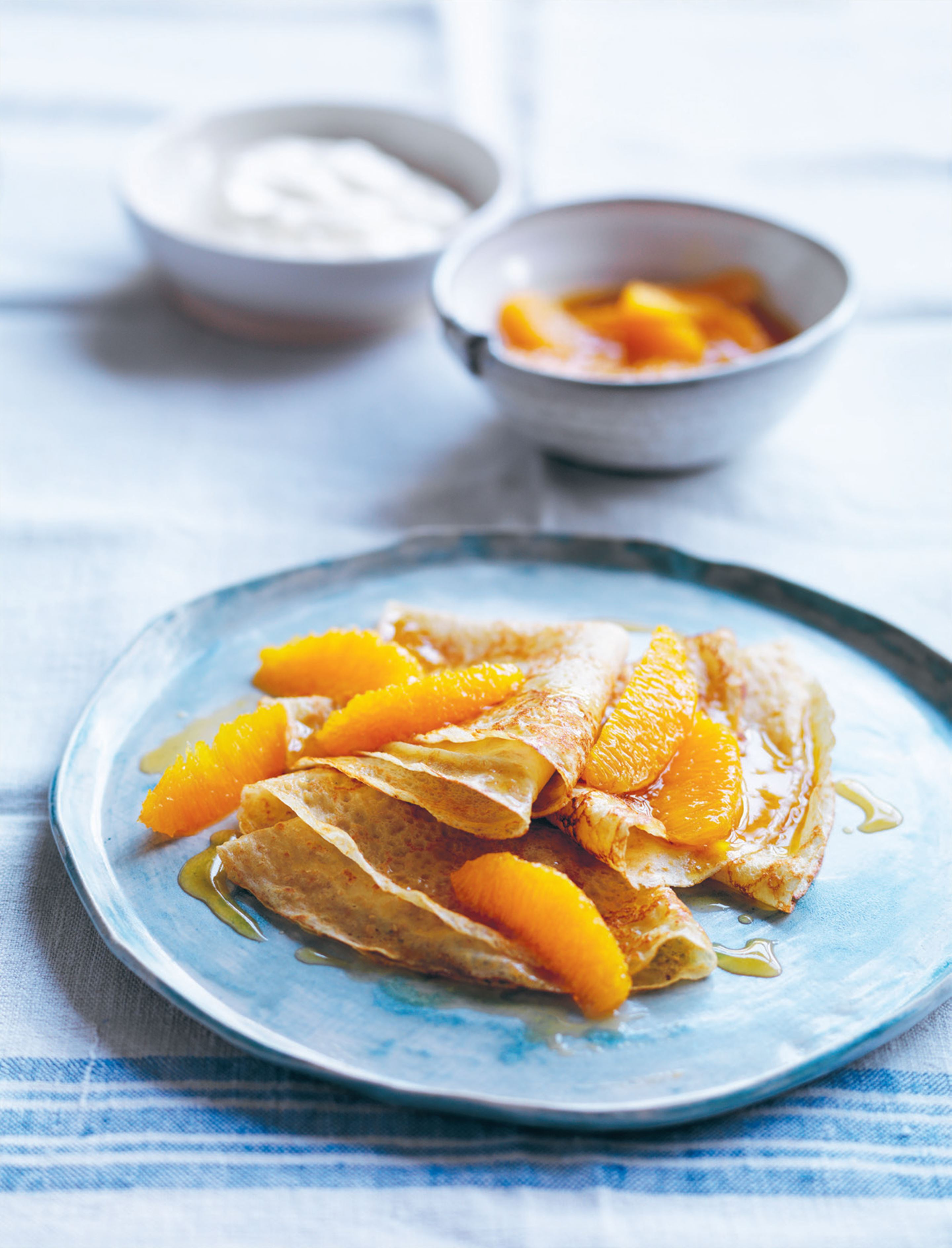 Crêpes with warm maple oranges