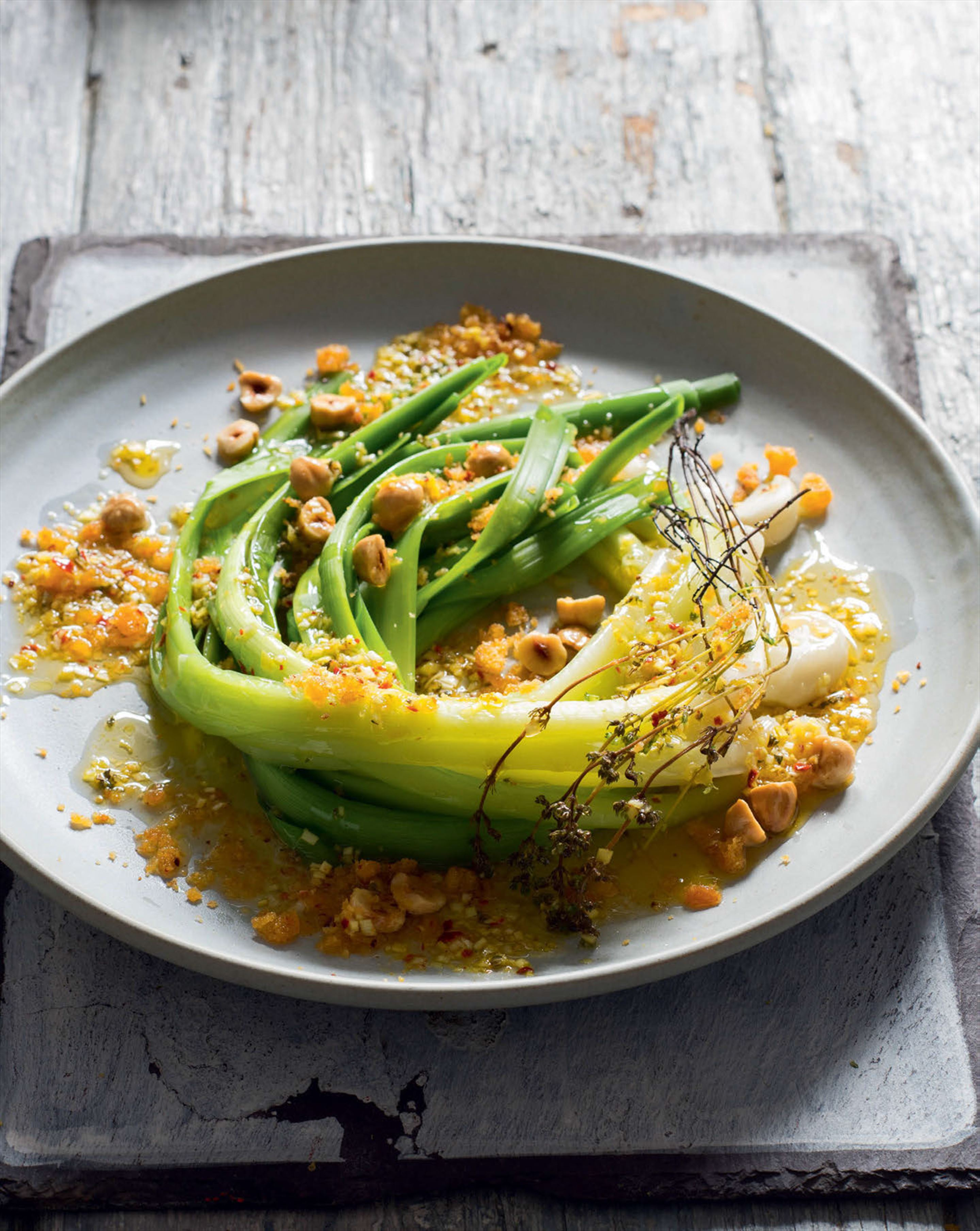 Baby leeks in saffron vinaigrette with hazelnut crumbs