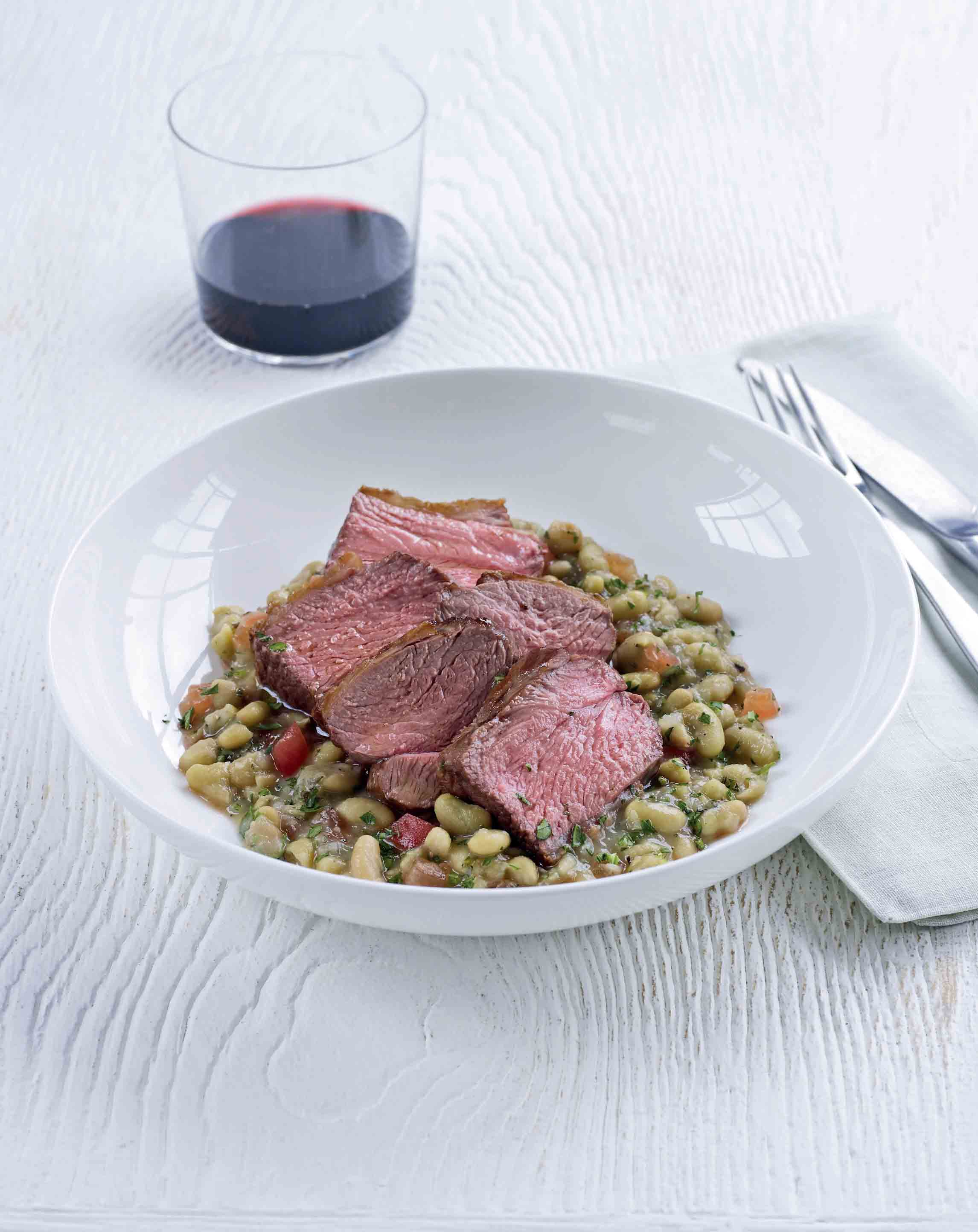 Rump of lamb with braised beans and tomatoes