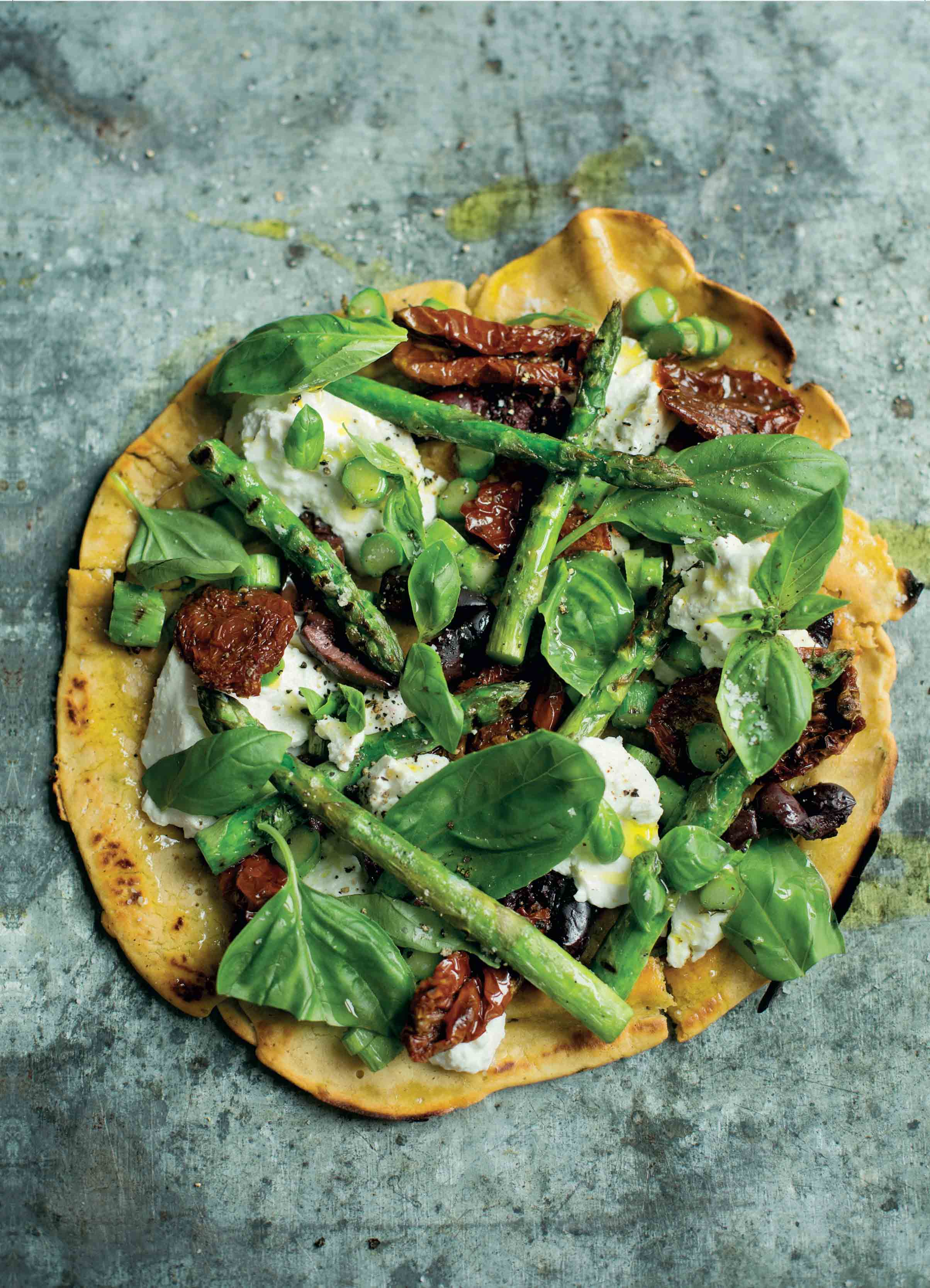 Socca pizza with char-grilled asparagus, olives and ricotta