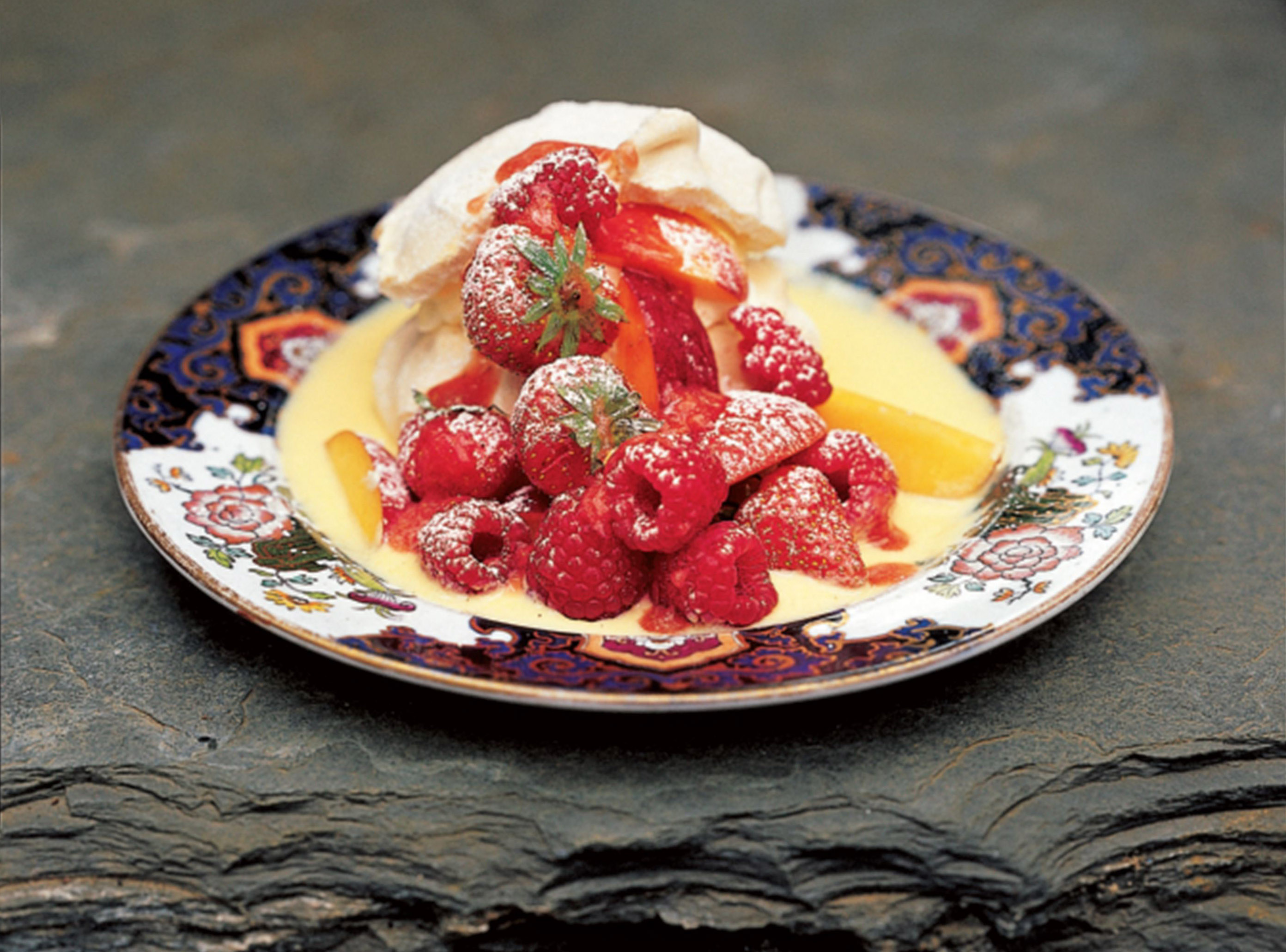 Meringues with summer fruits and crème anglaise