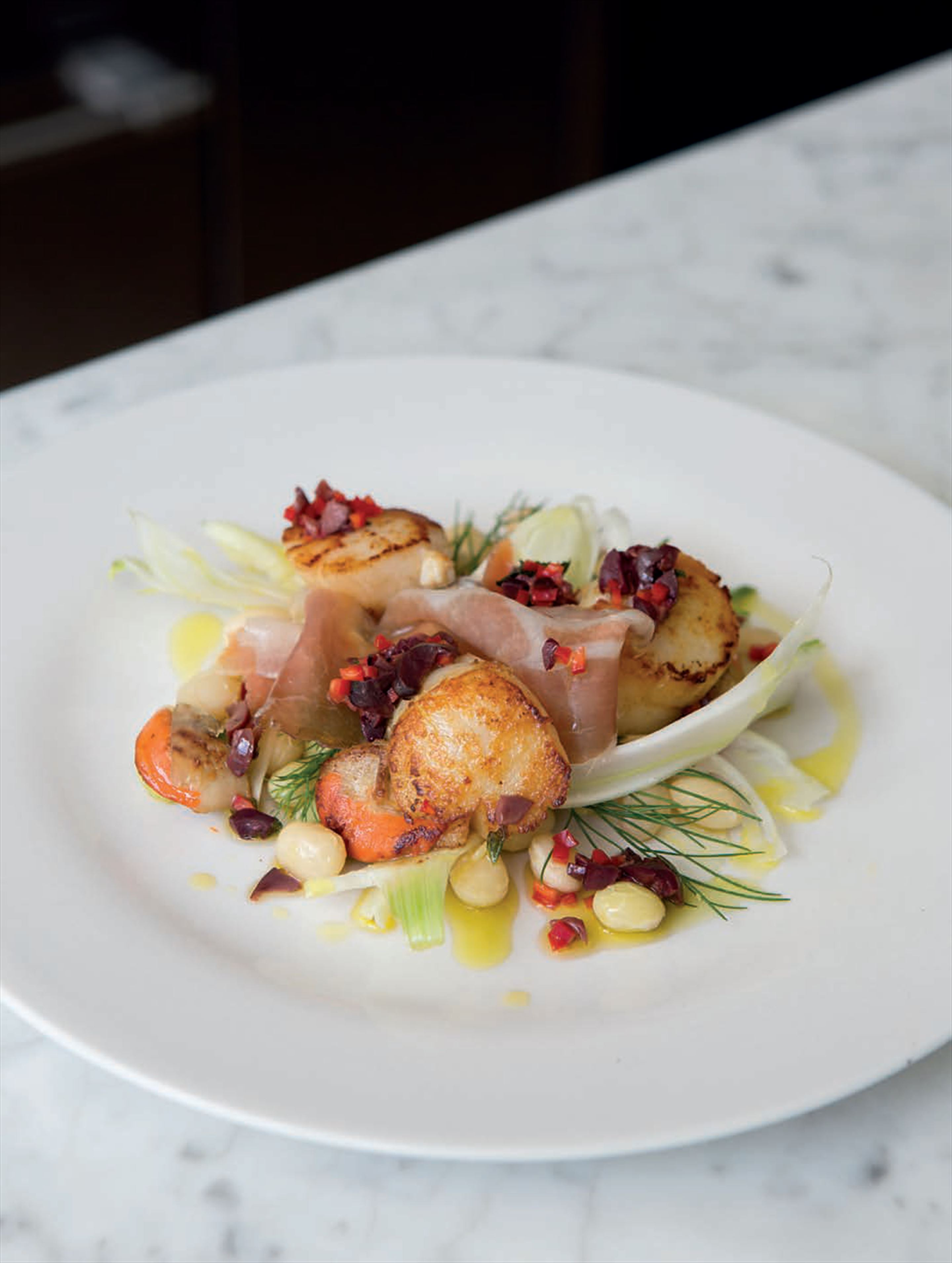Scallops with white beans, fennel and speck