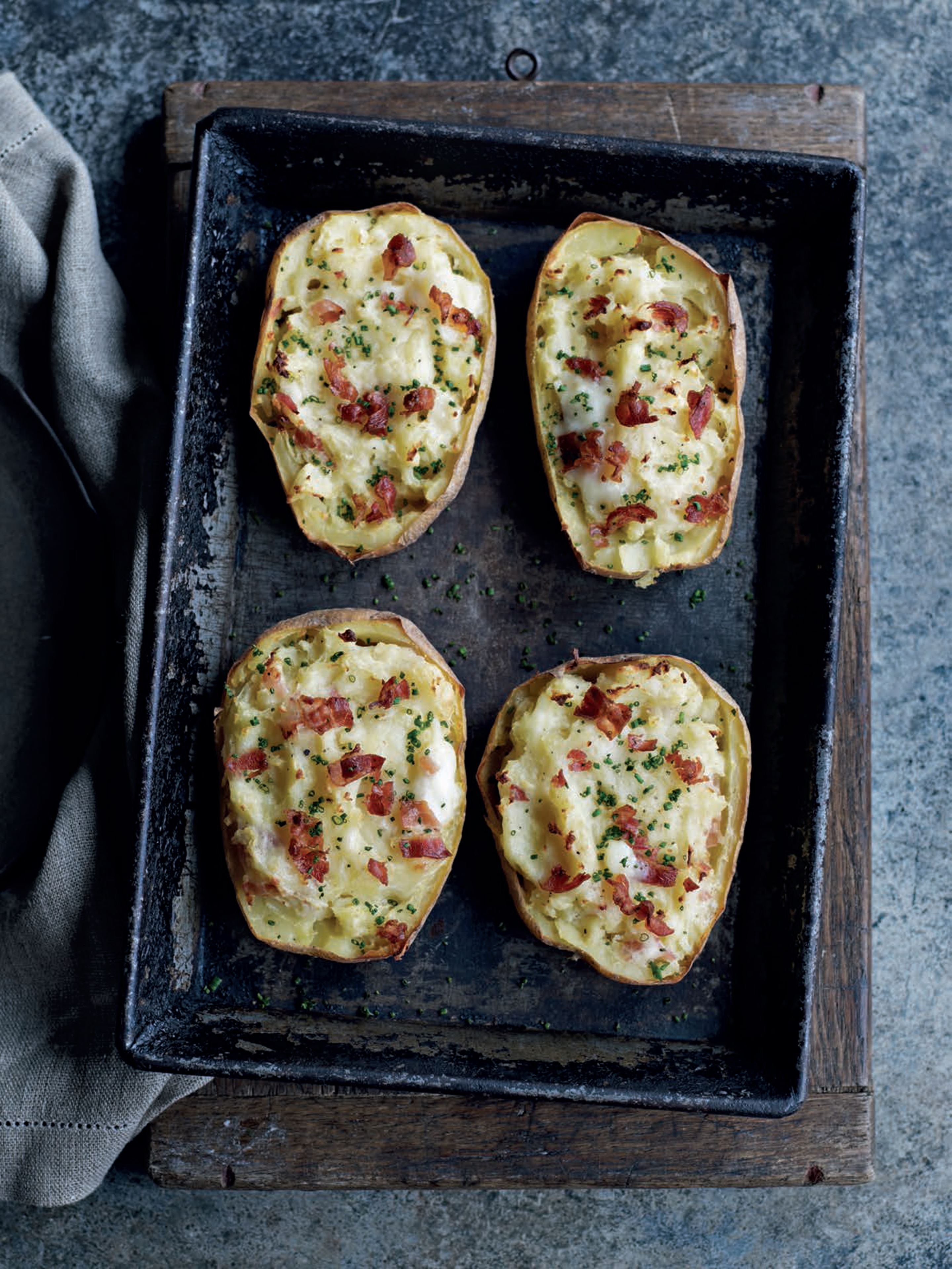 Baked potatoes with pancetta and taleggio