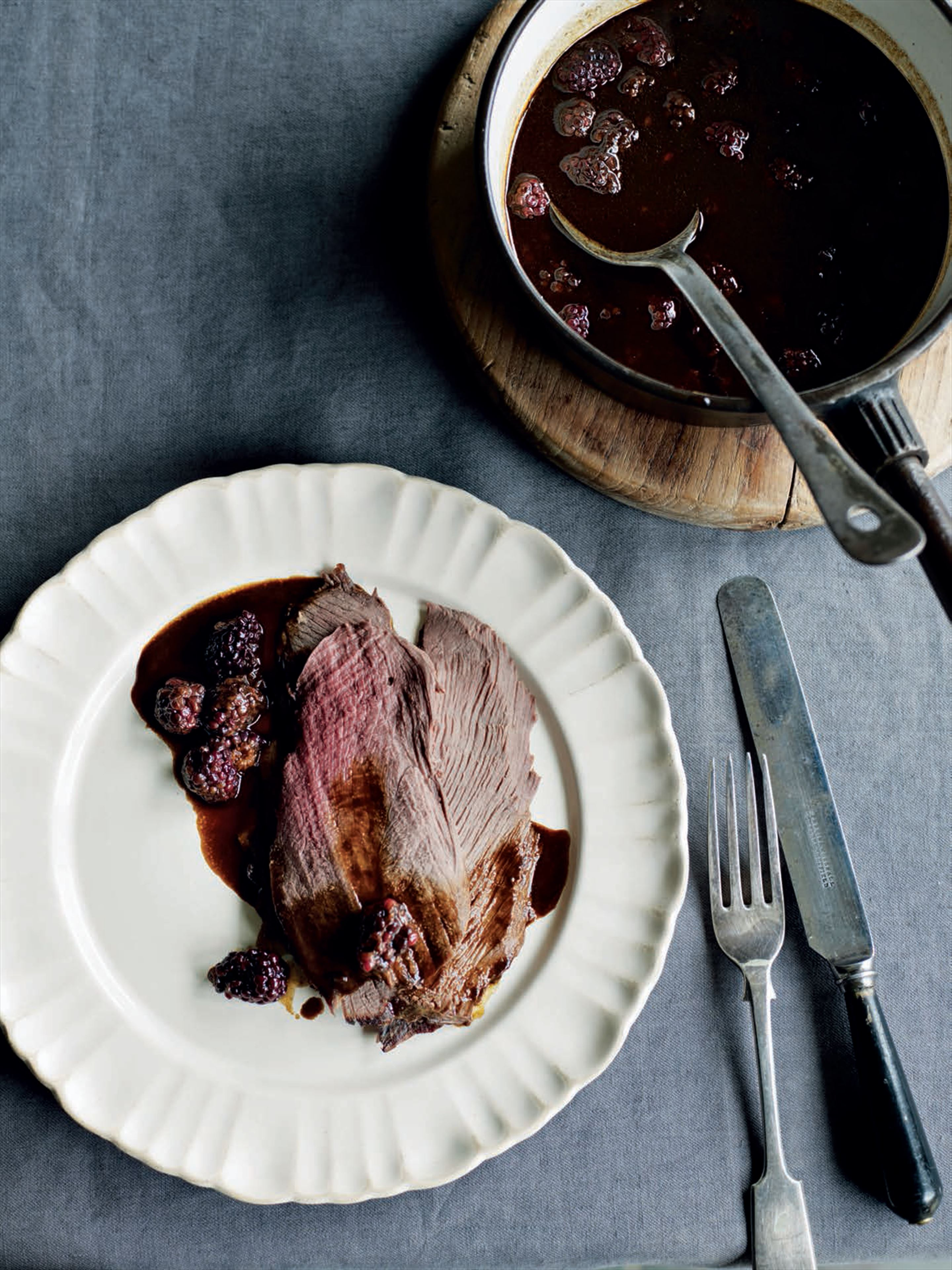 Roast haunch of venison with blackberries