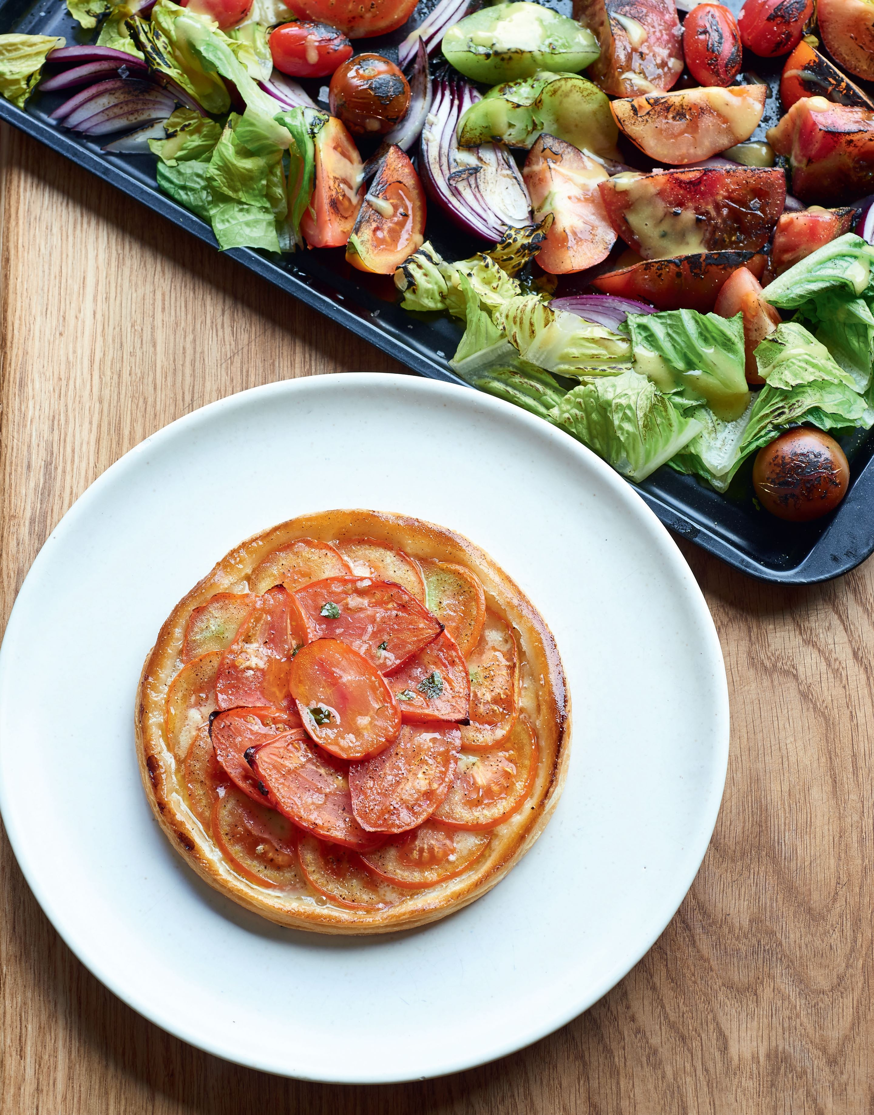 Tomato tarts with blowtorched salad