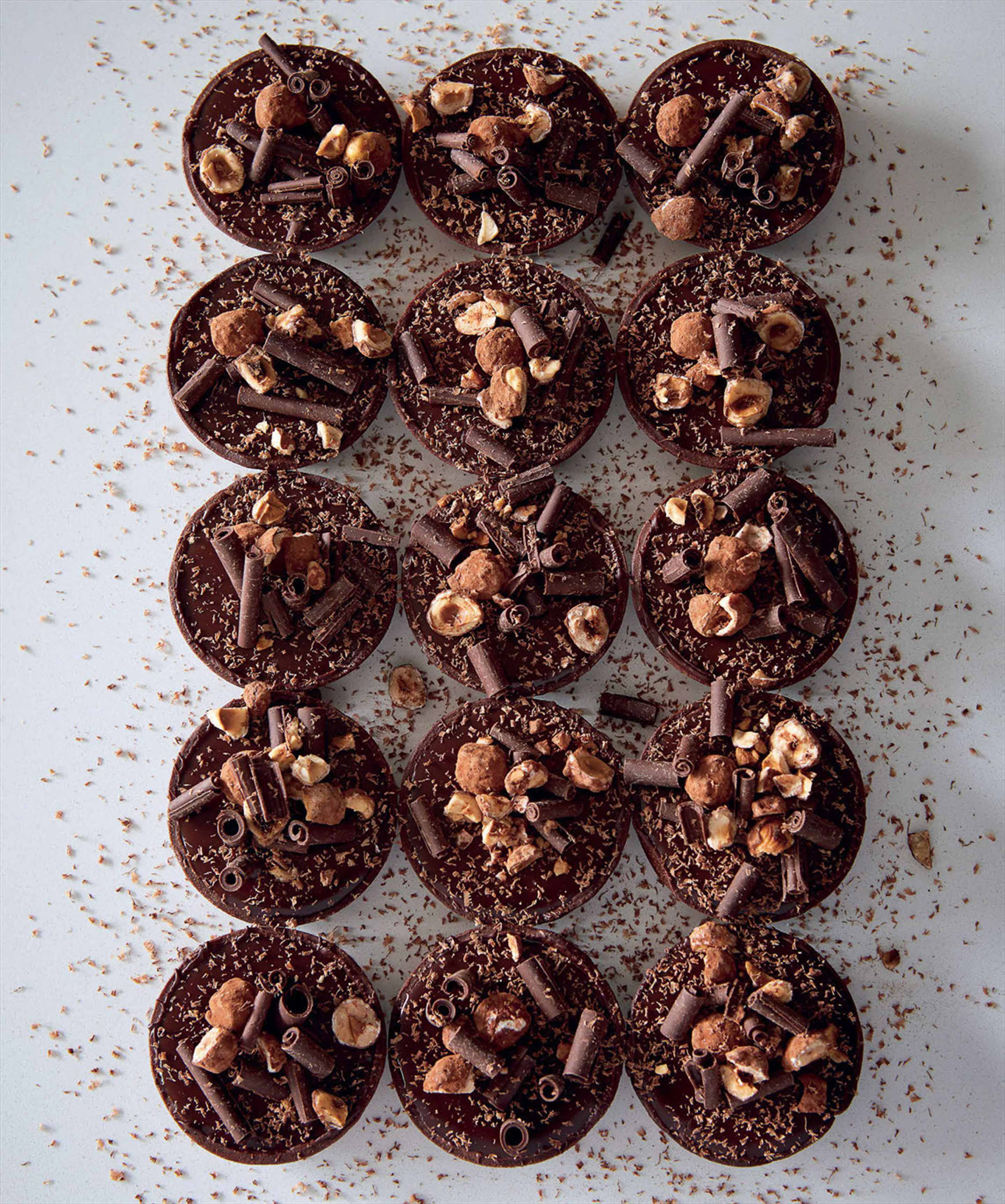 Chocolate and salted caramel tarts with caramelised hazelnuts
