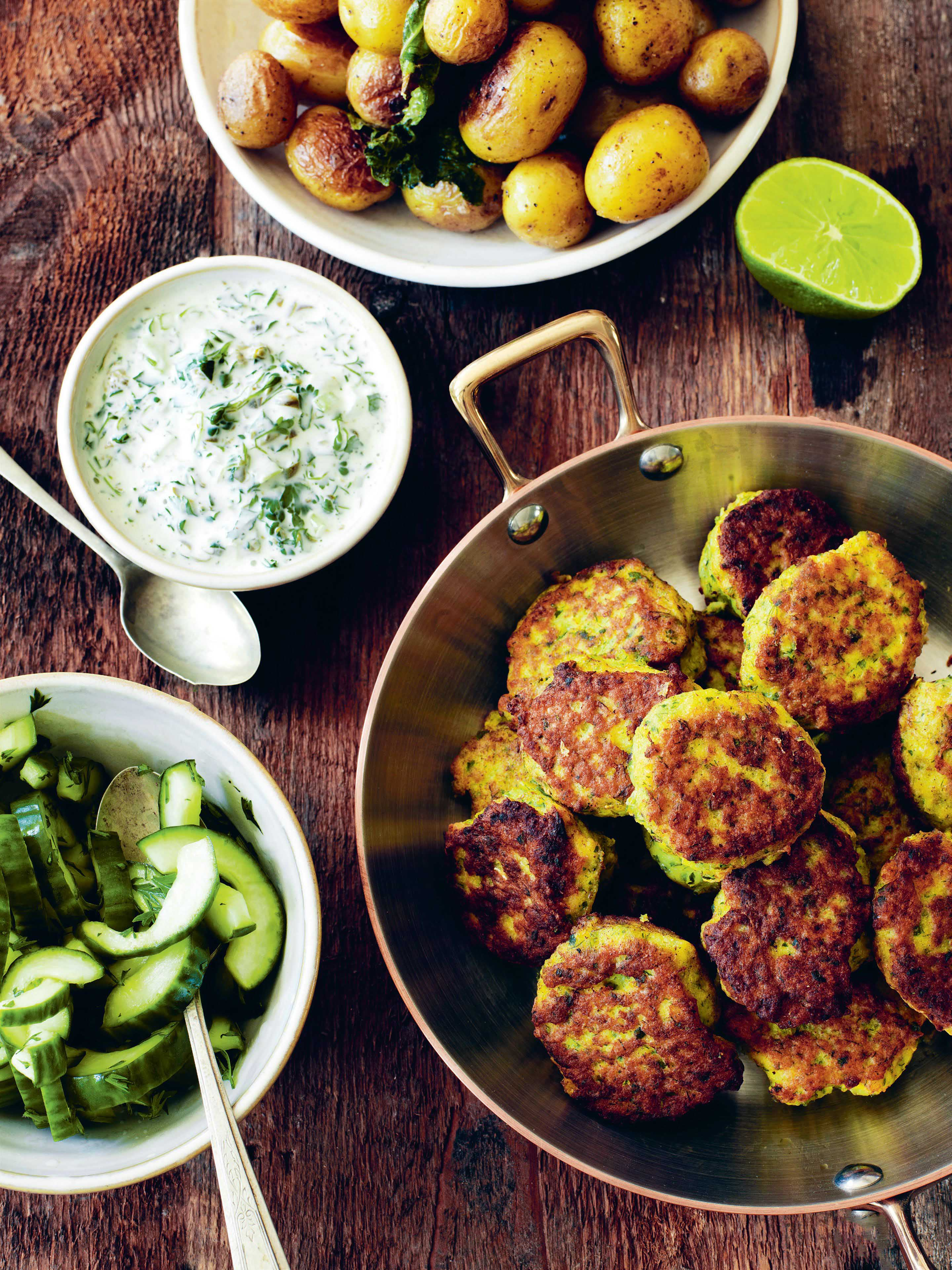 Fishcakes with herb sauce and mint fried potatoes
