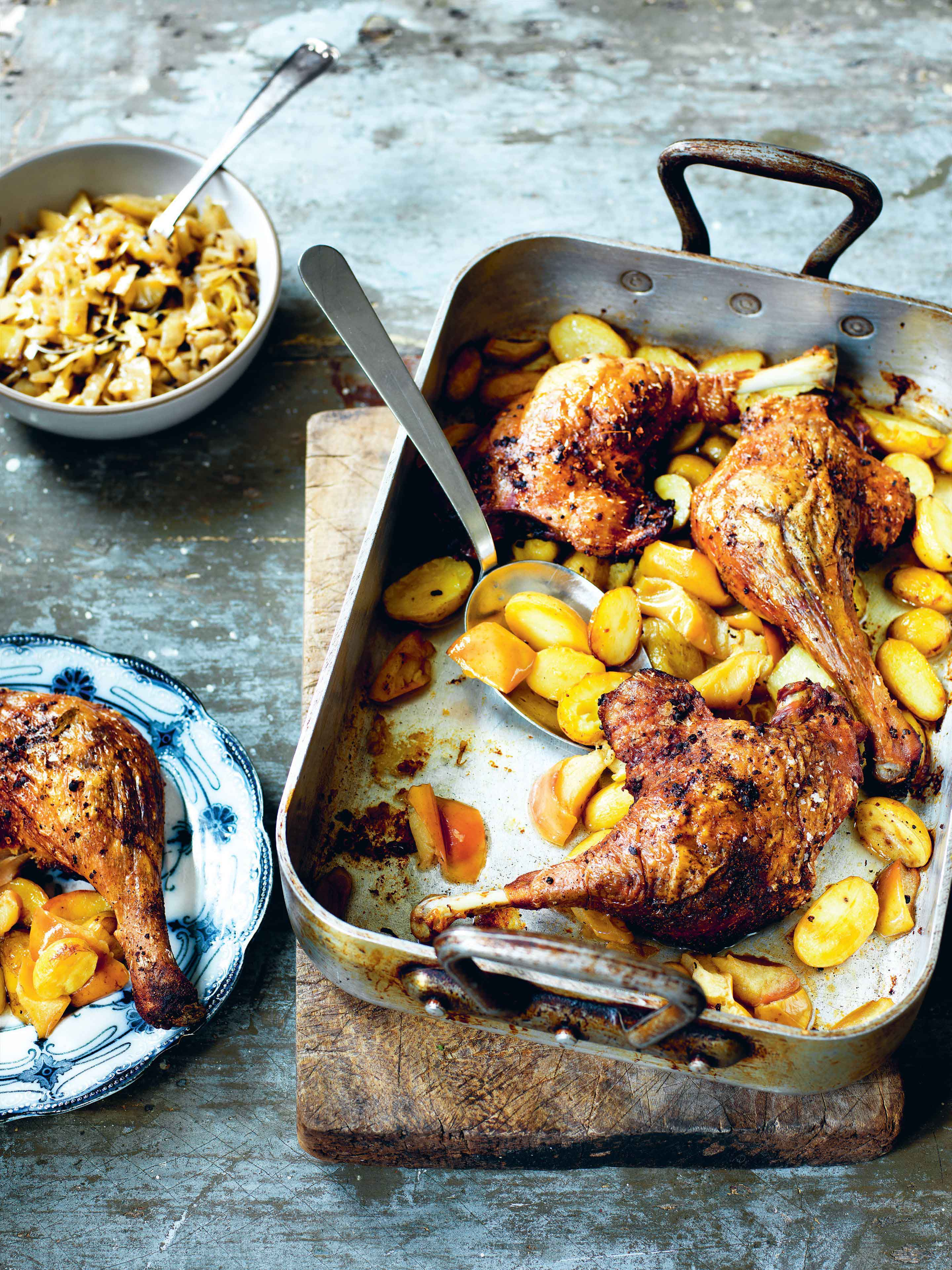 Duck legs with potatoes, apples and brown cabbage