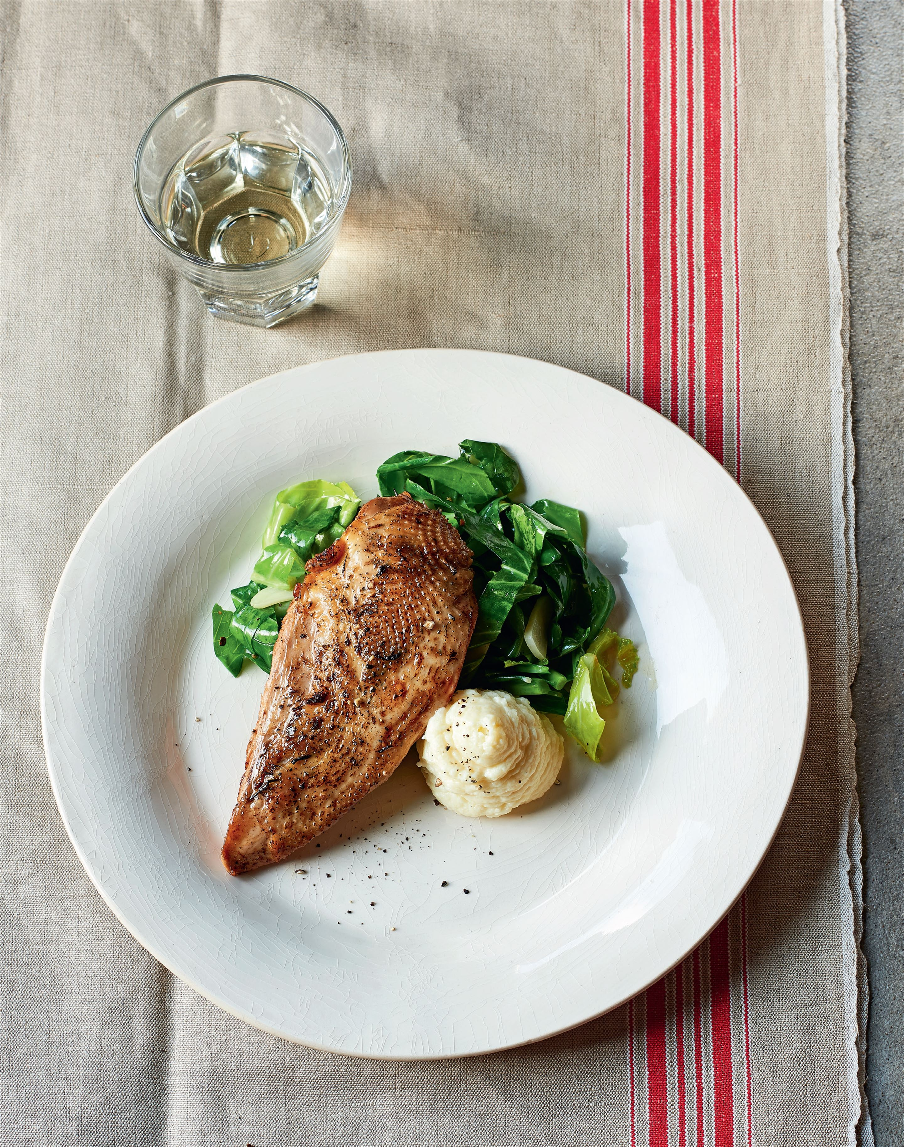 Pheasant breast with onion purée & spring greens