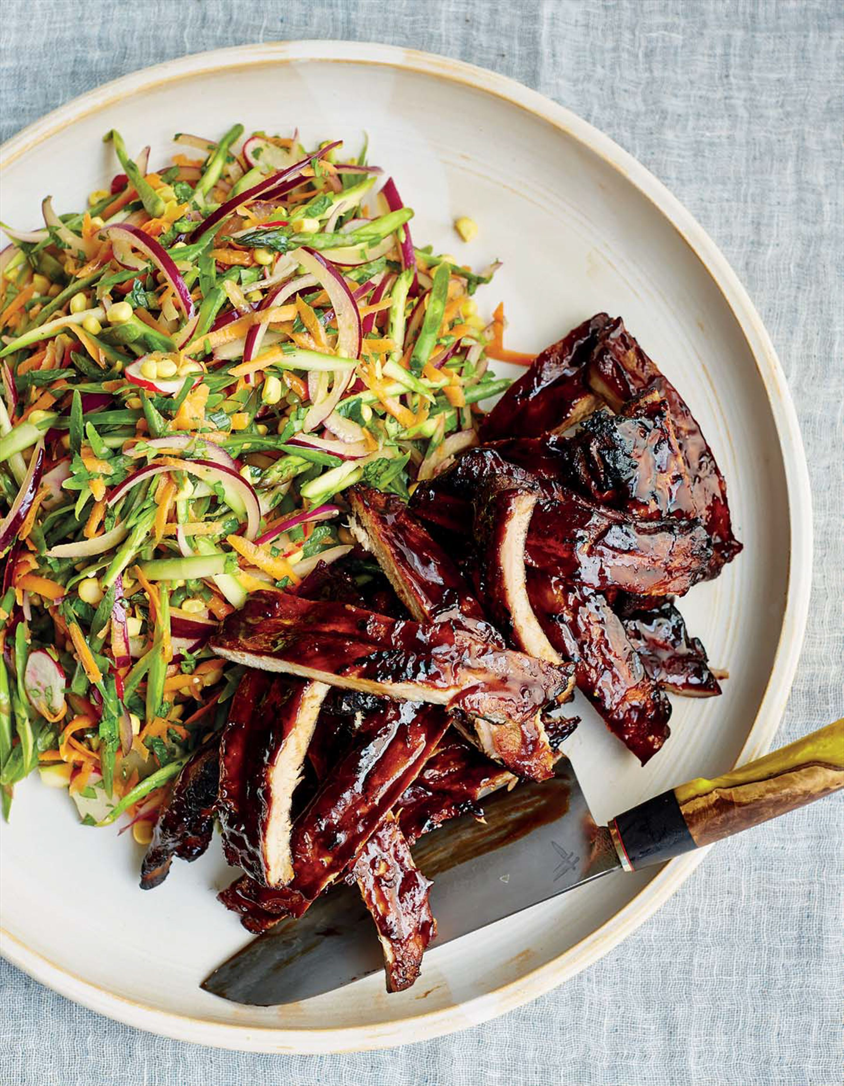 Barbecued ribs with summer vegetable slaw