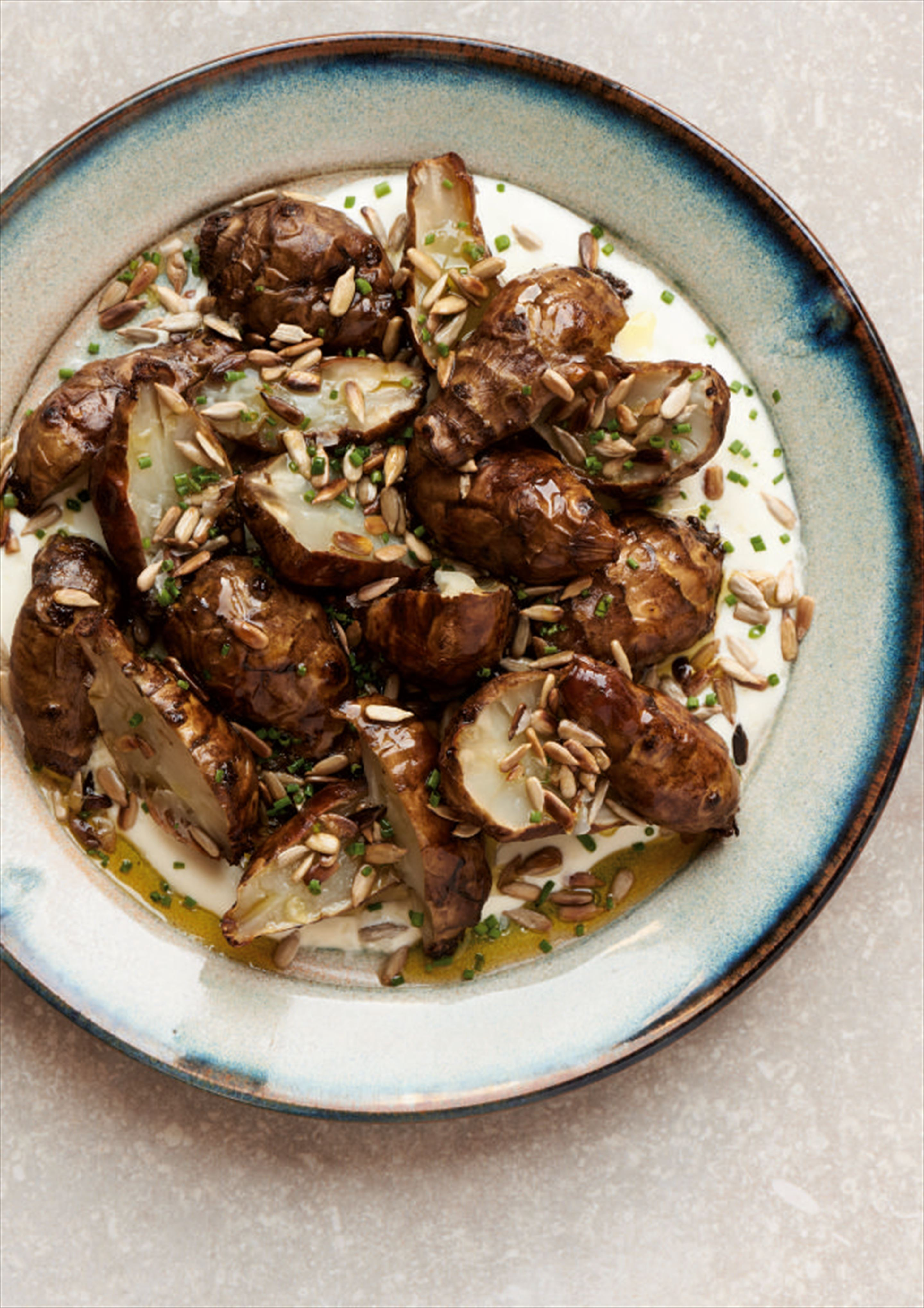 Baked Jerusalem artichokes with yoghurt and sunflower seeds