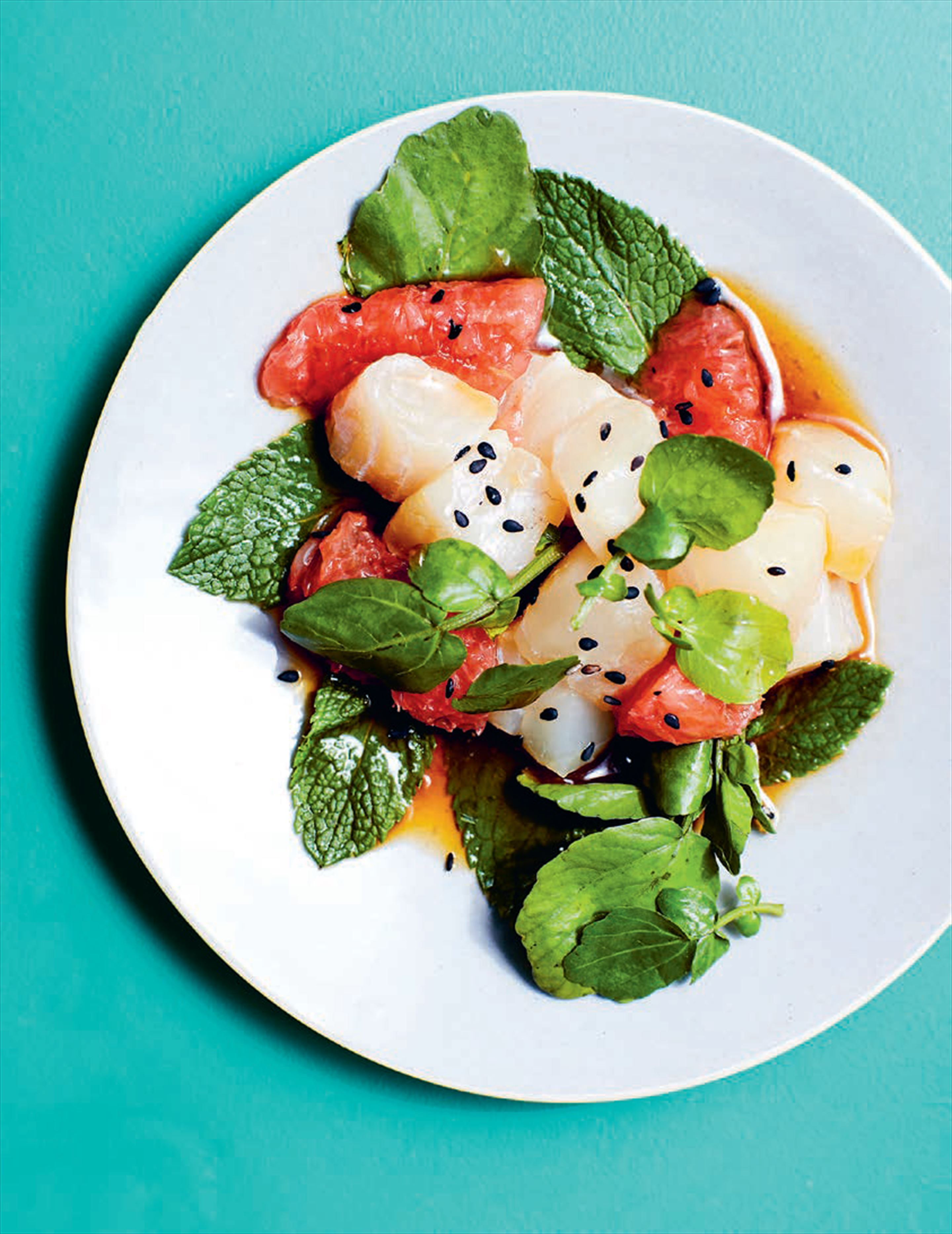 Sour sea bass with grapefruit, mint + baby watercress in a ponzu dressing