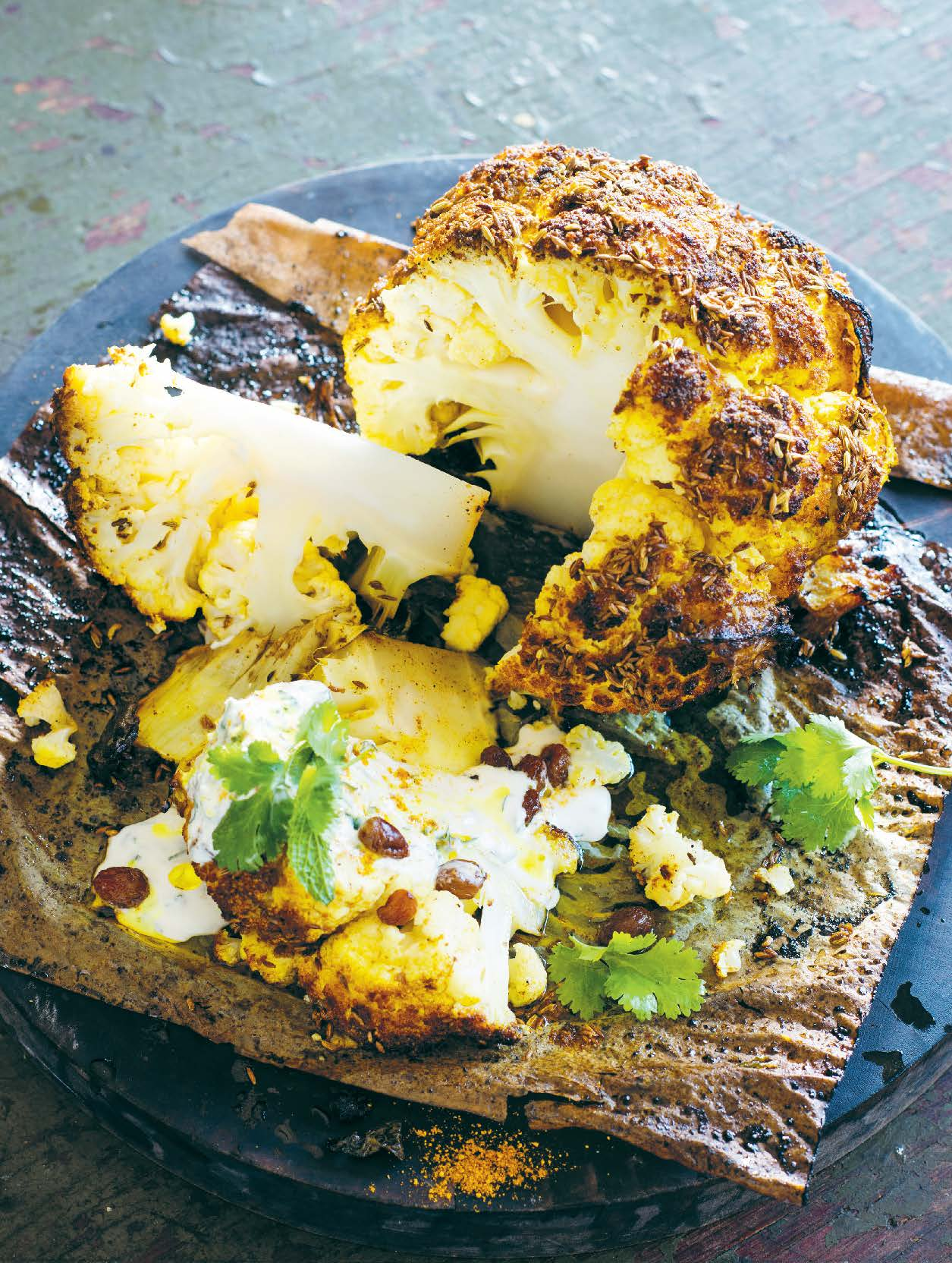 Baked whole cauliflower with Indian spices, mint and yoghurt