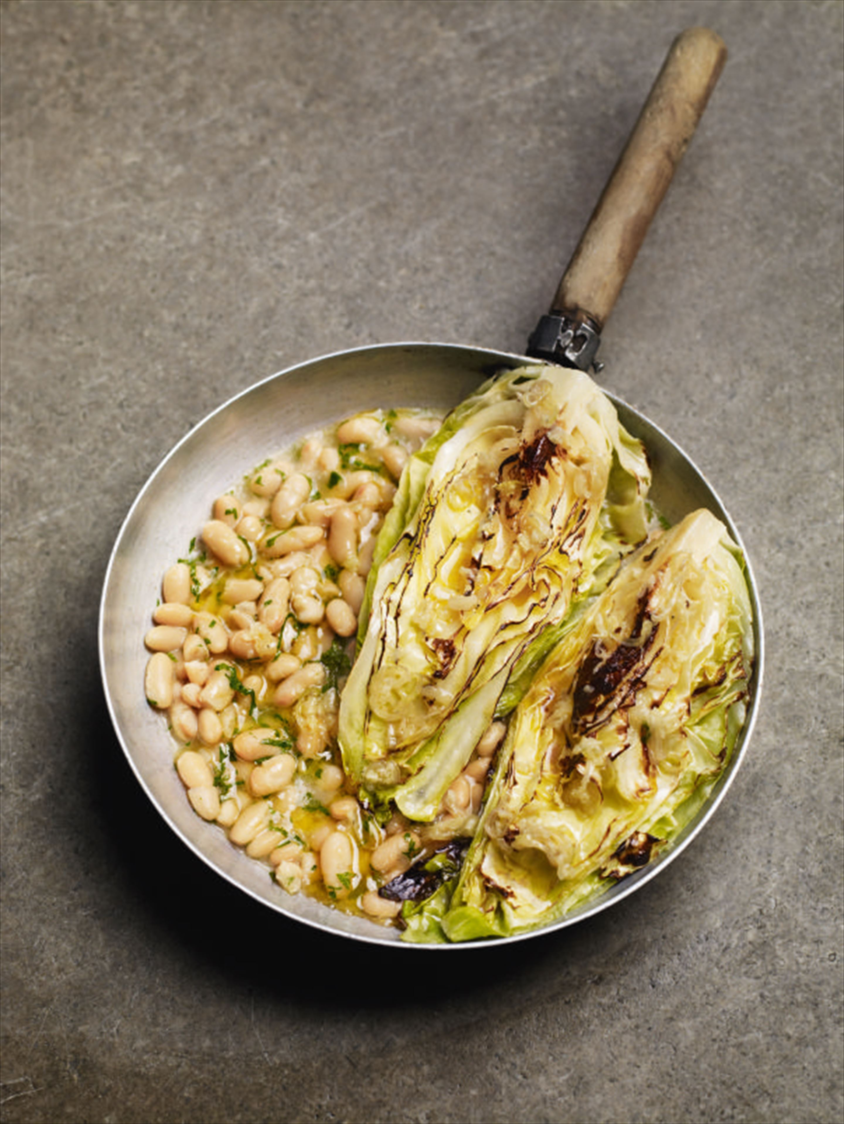 Grilled cabbage with garlic butter and cannellini beans