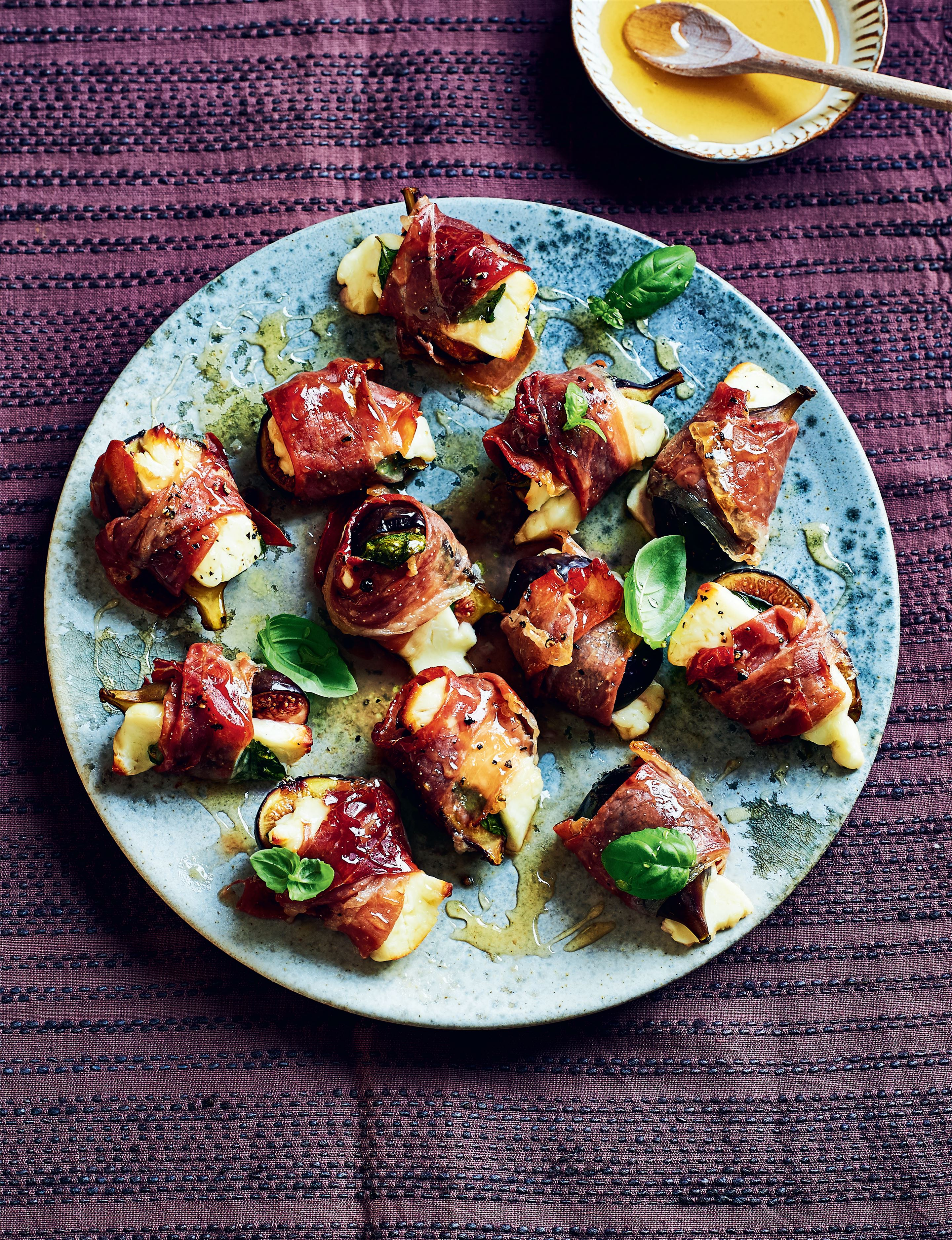 Baked figs, halloumi, prosciutto and basil