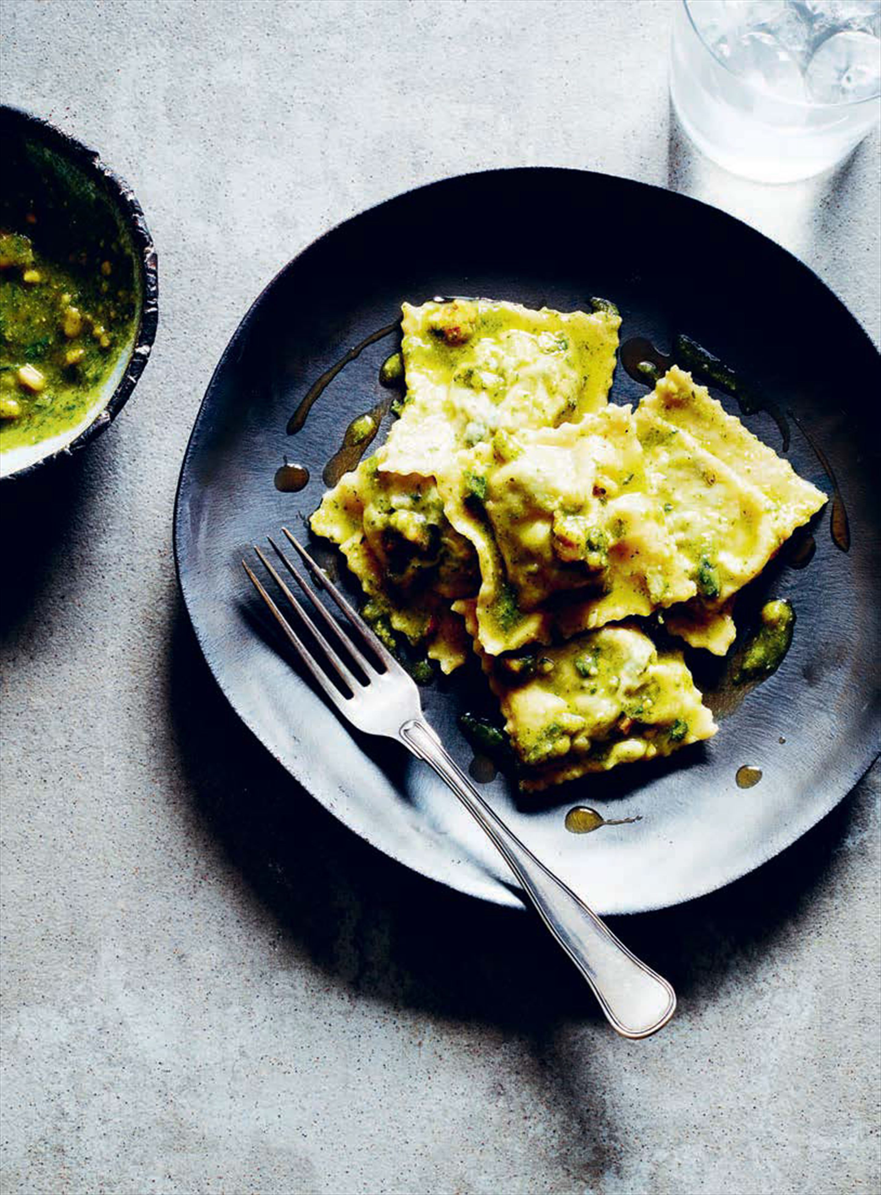 Spinach and ricotta ravioli with basil and walnut pesto
