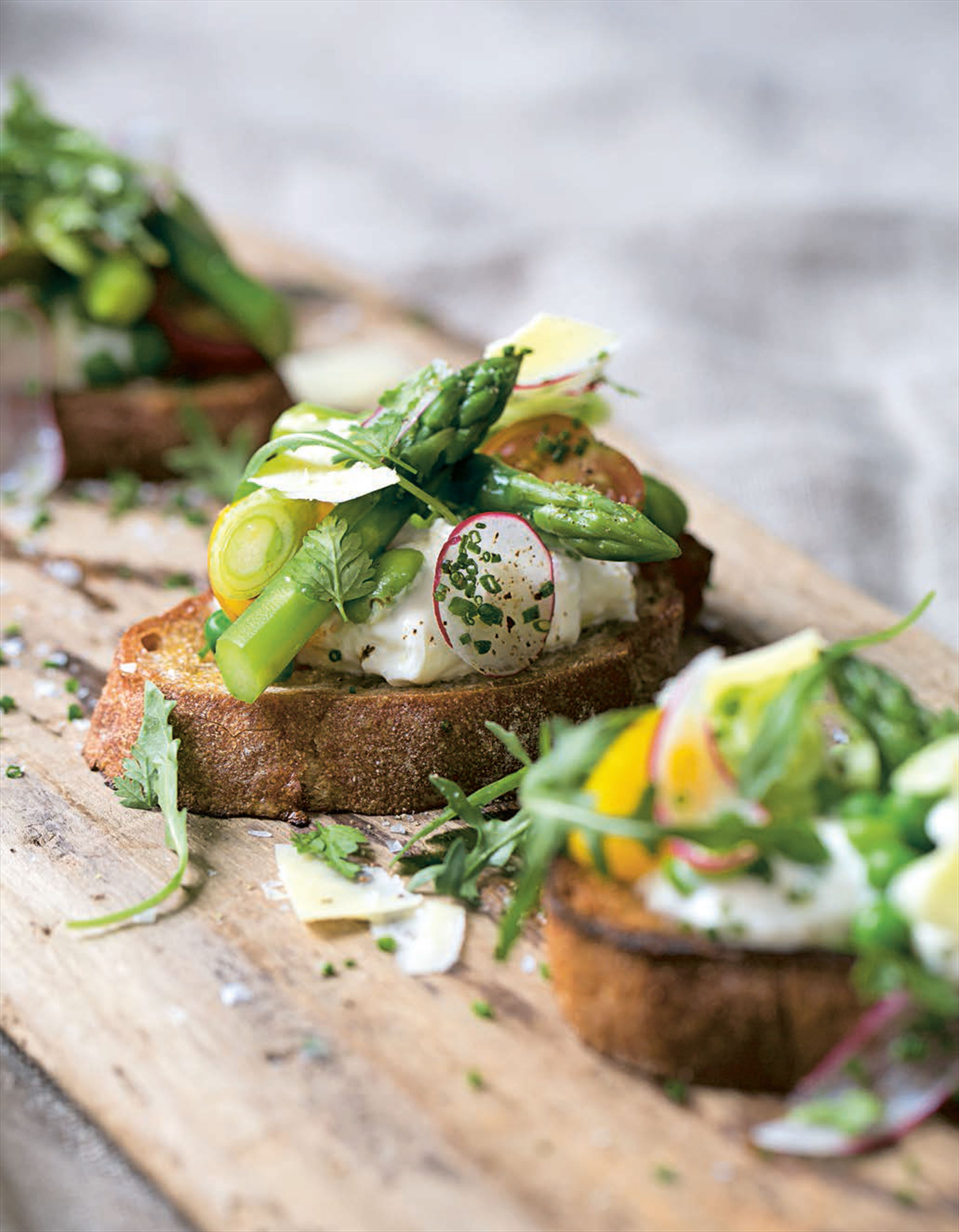 Spring vegetable tartine with creamed burrata