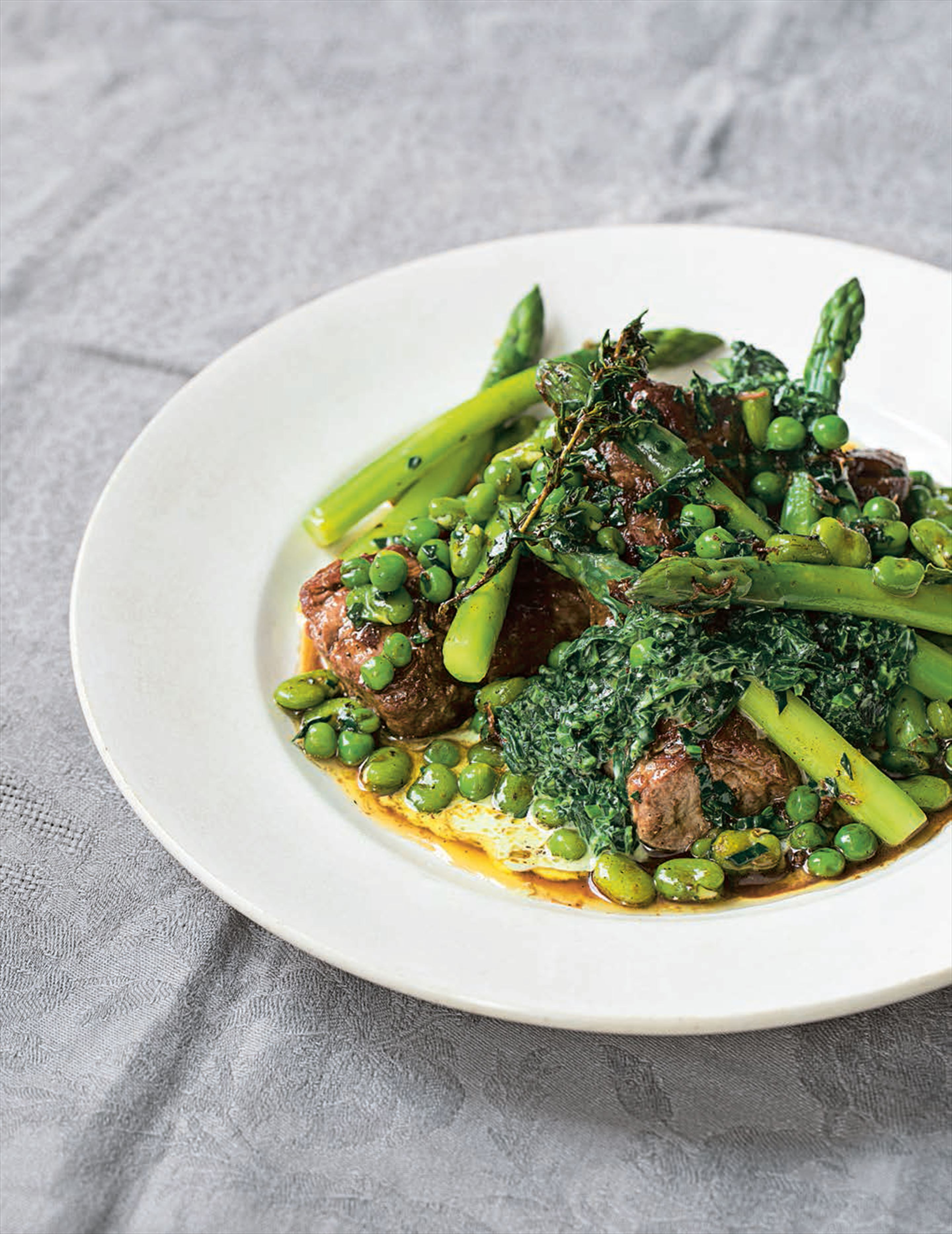 Braised lamb neck, peas, broad beans, asparagus and creamed wild garlic