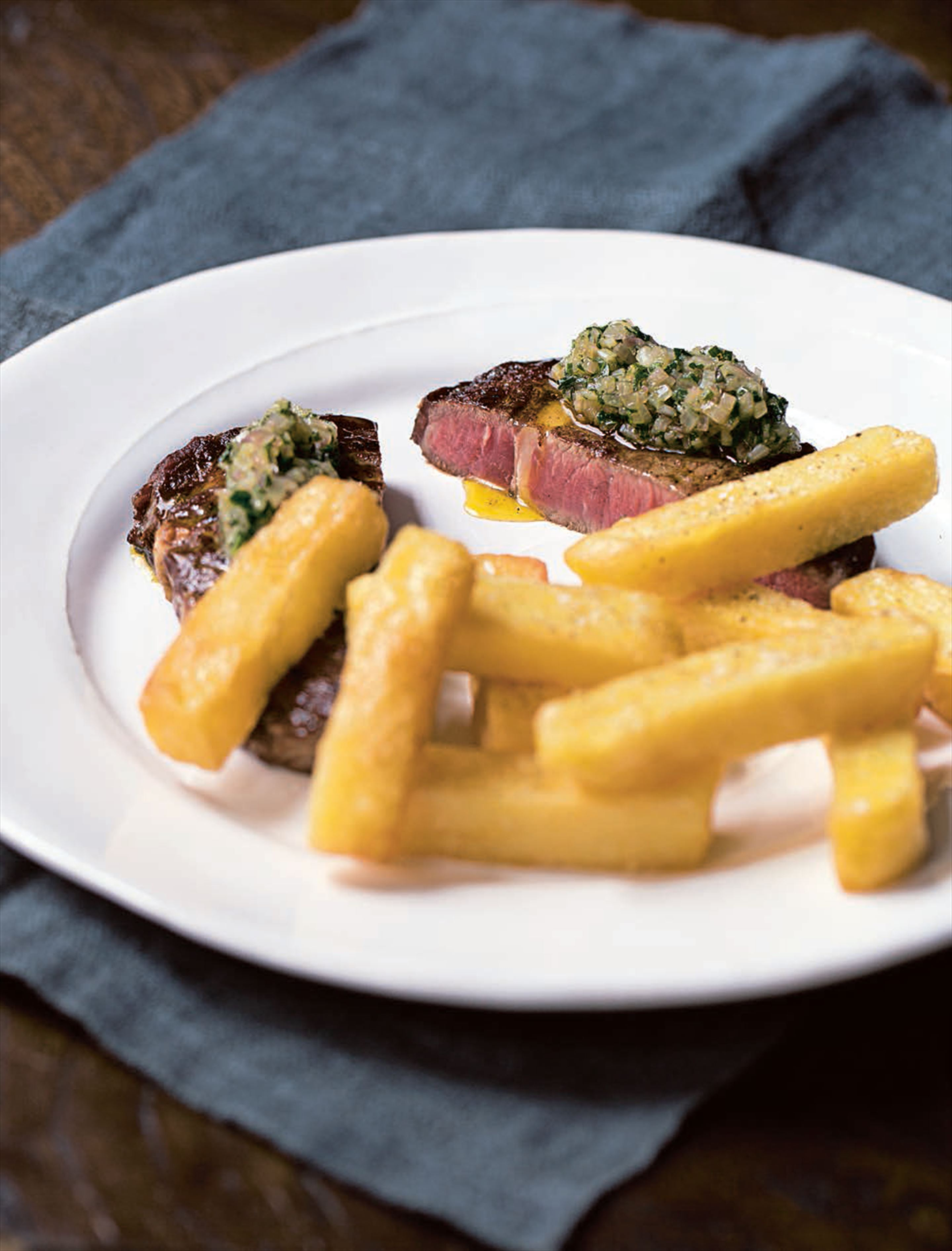 Chargrilled rib-eye steaks with chimichurri sauce