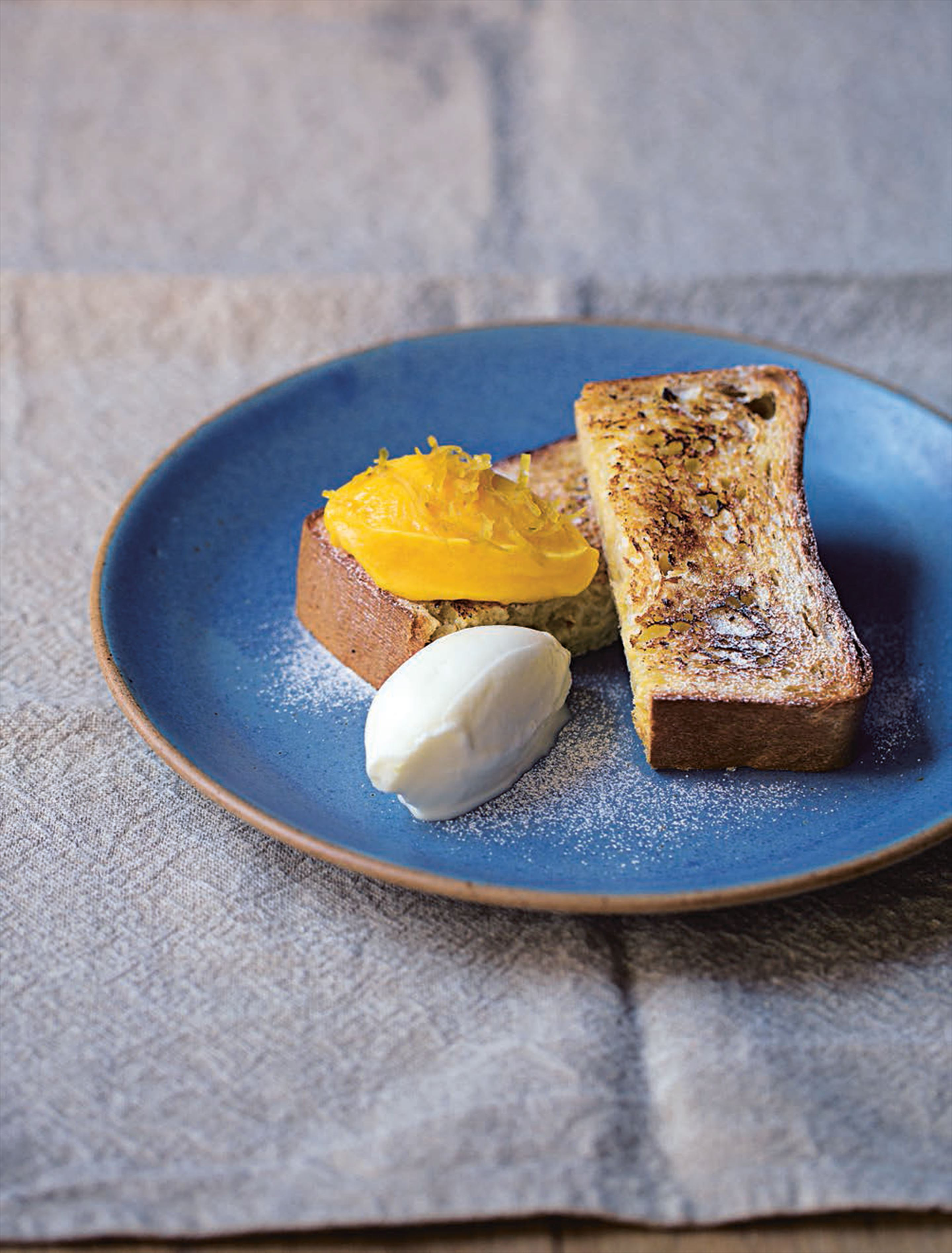 Grilled brioche with lemon curd and yoghurt sorbet