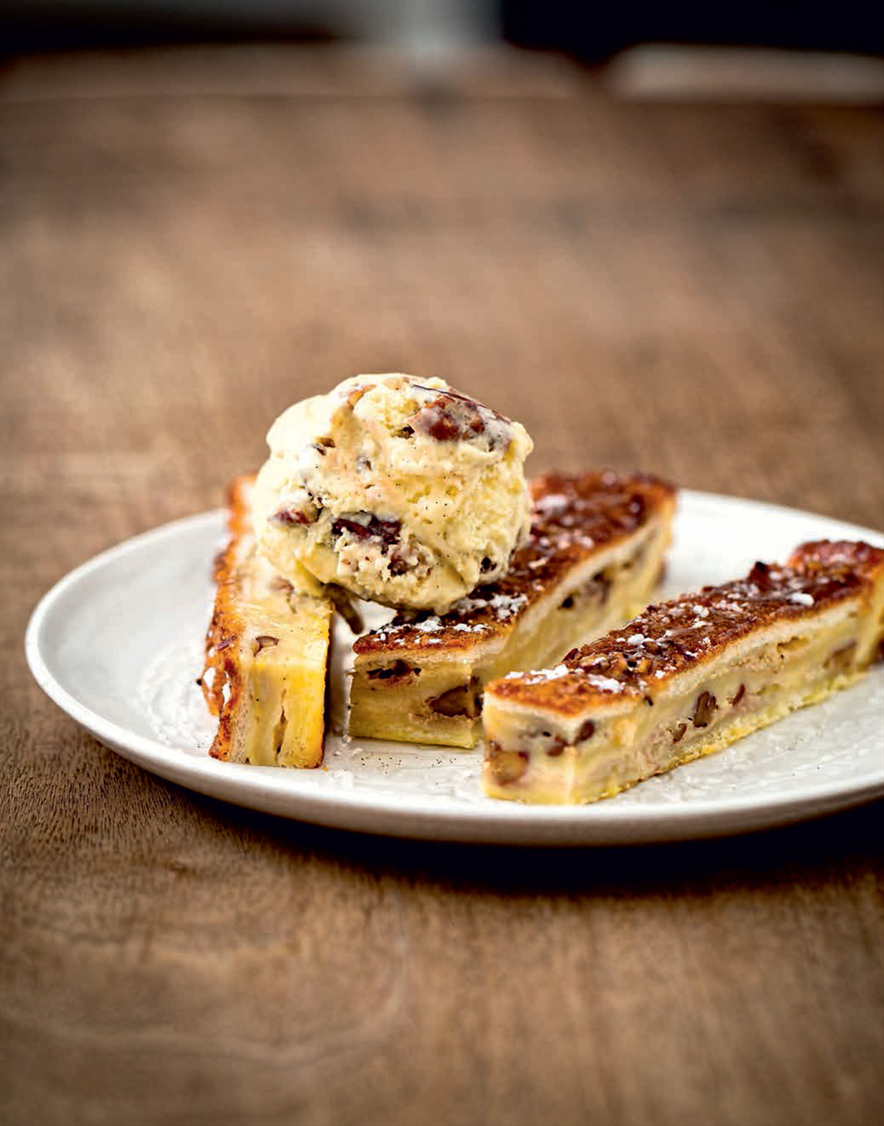 Bread and butter pudding with vanilla and pecan ice cream