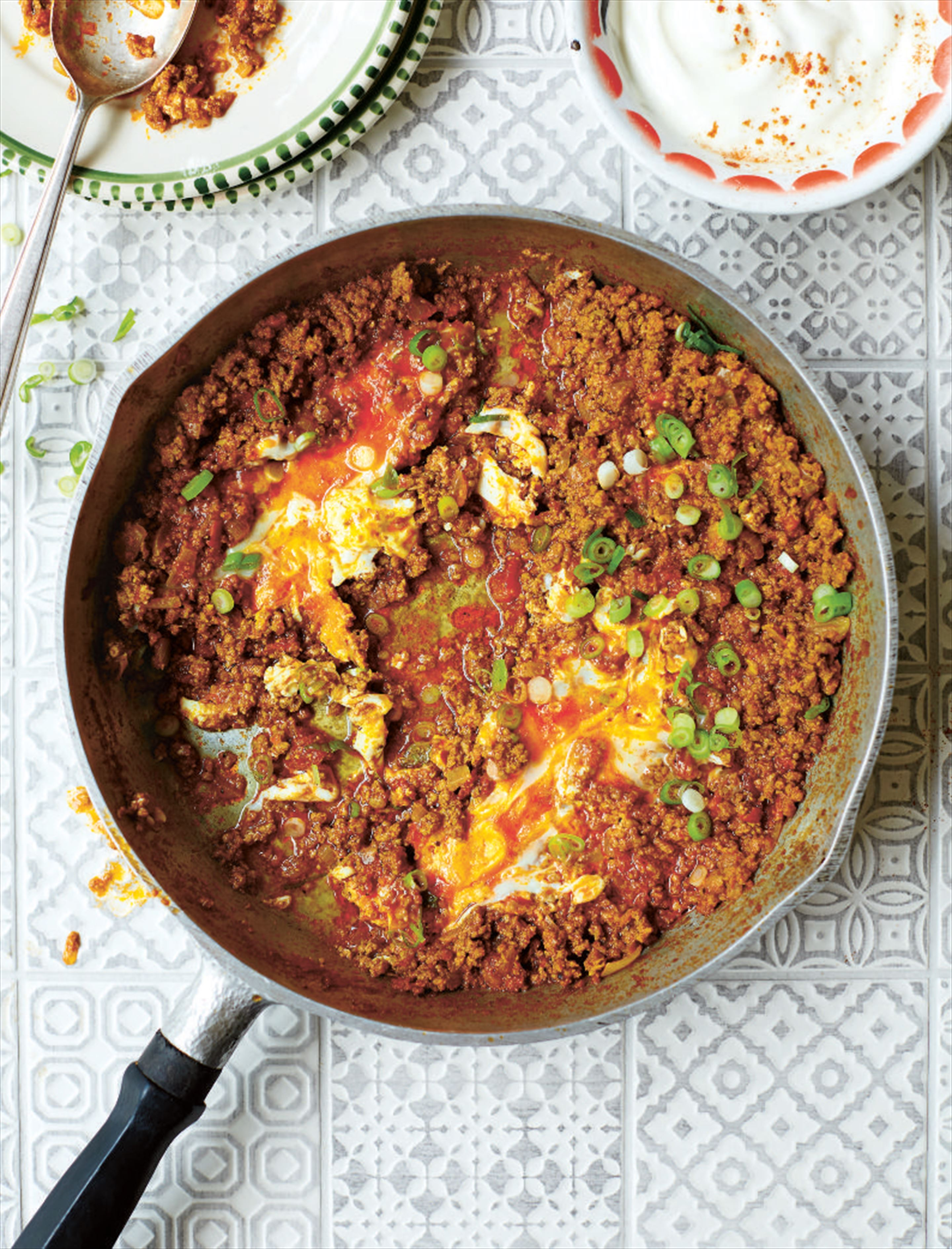 Spiced beef with eggs and spring onions