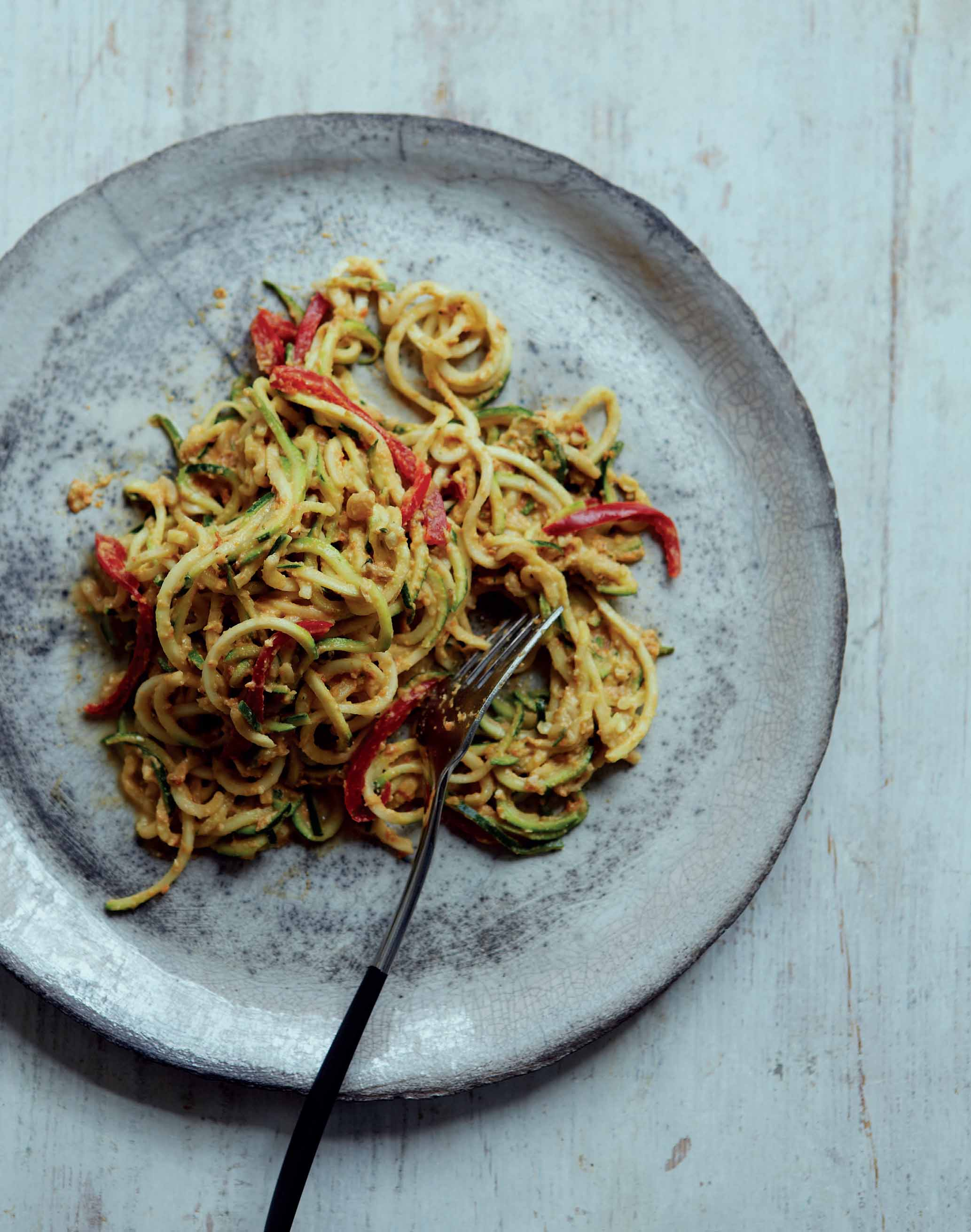 Courgetti spaghetti with a sun-dried tomato, basil and avocado sauce
