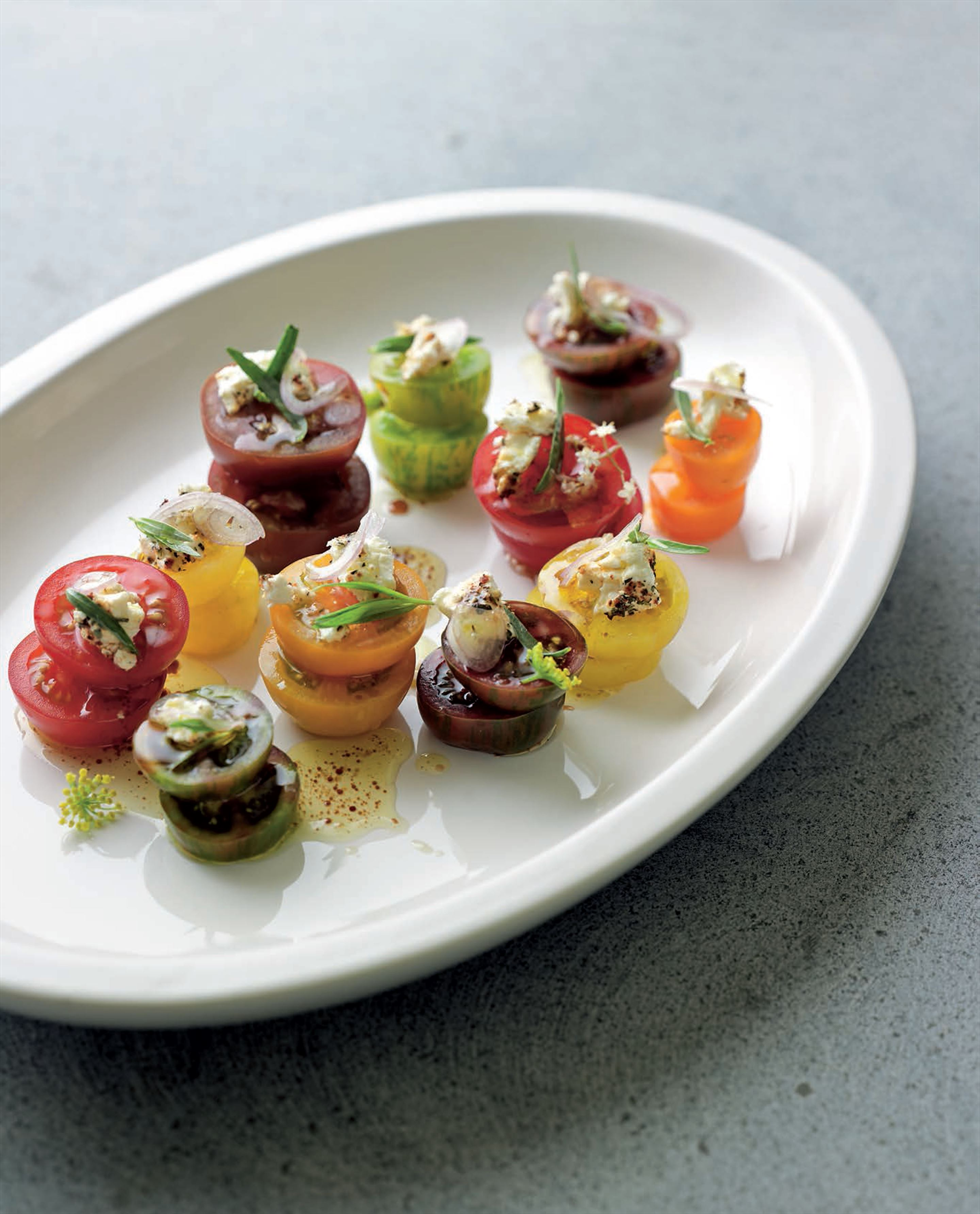 Tomato salad with tarragon, shankleish cheese and sumac dressing