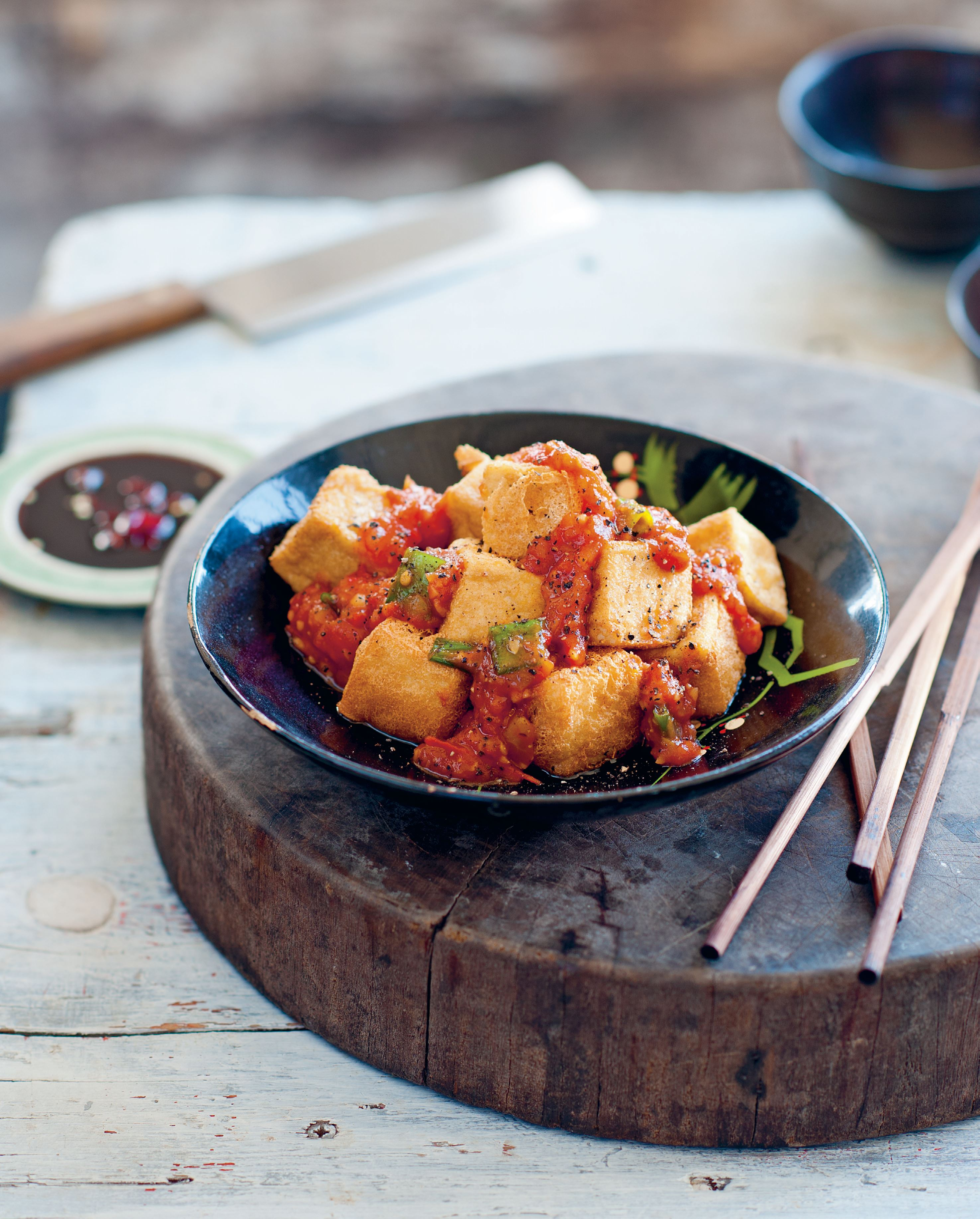 Crisp tofu cooked in tomato-pepper sauce