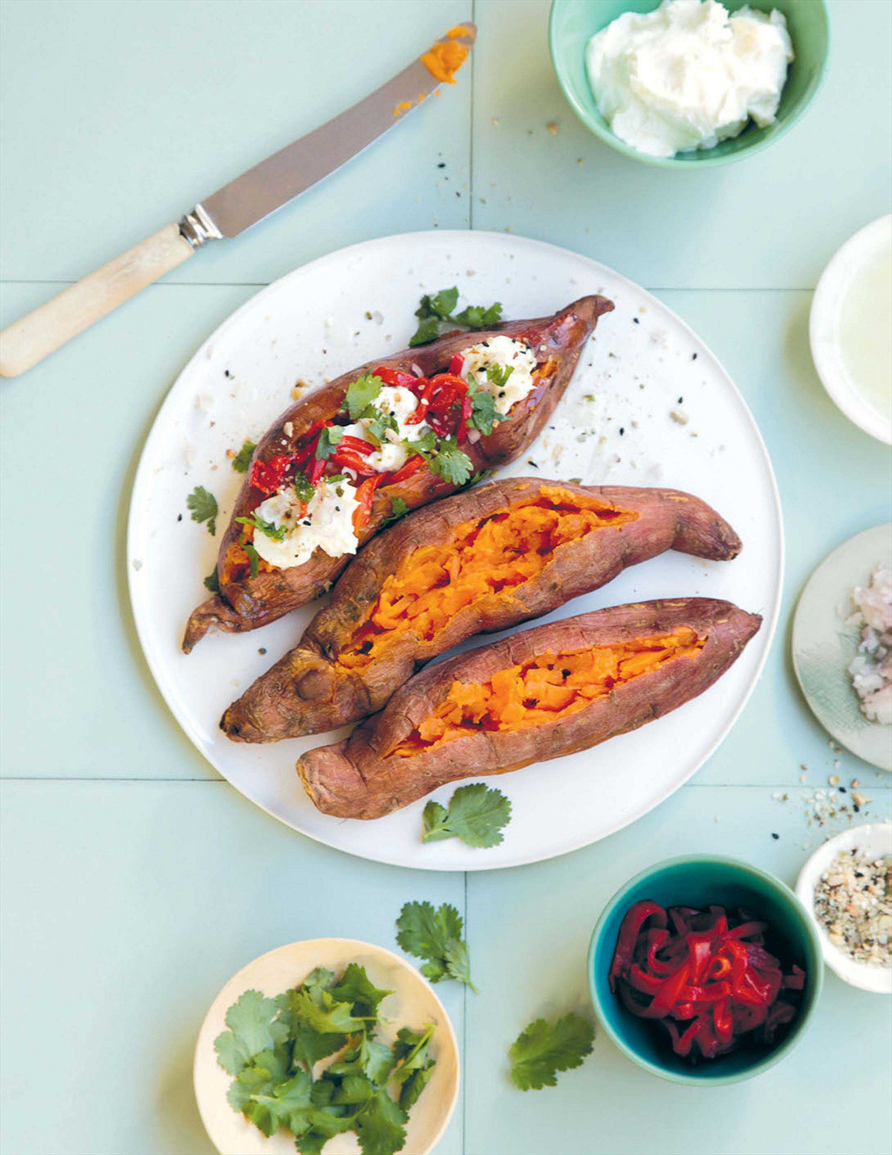 Roasted sweet potatoes with hot red Turkish peppers and labneh