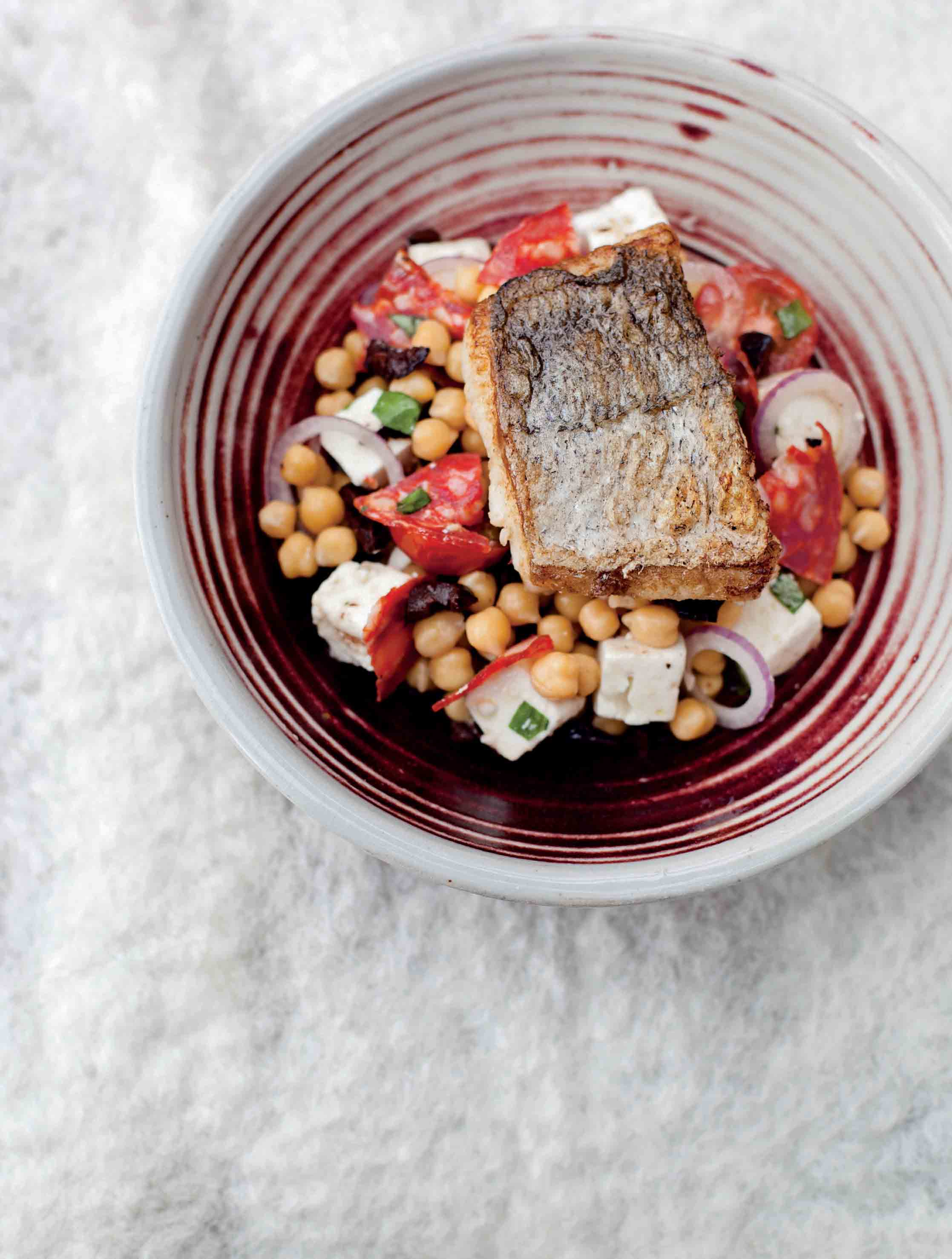 Roasted hake with chickpea, feta and red onion salad