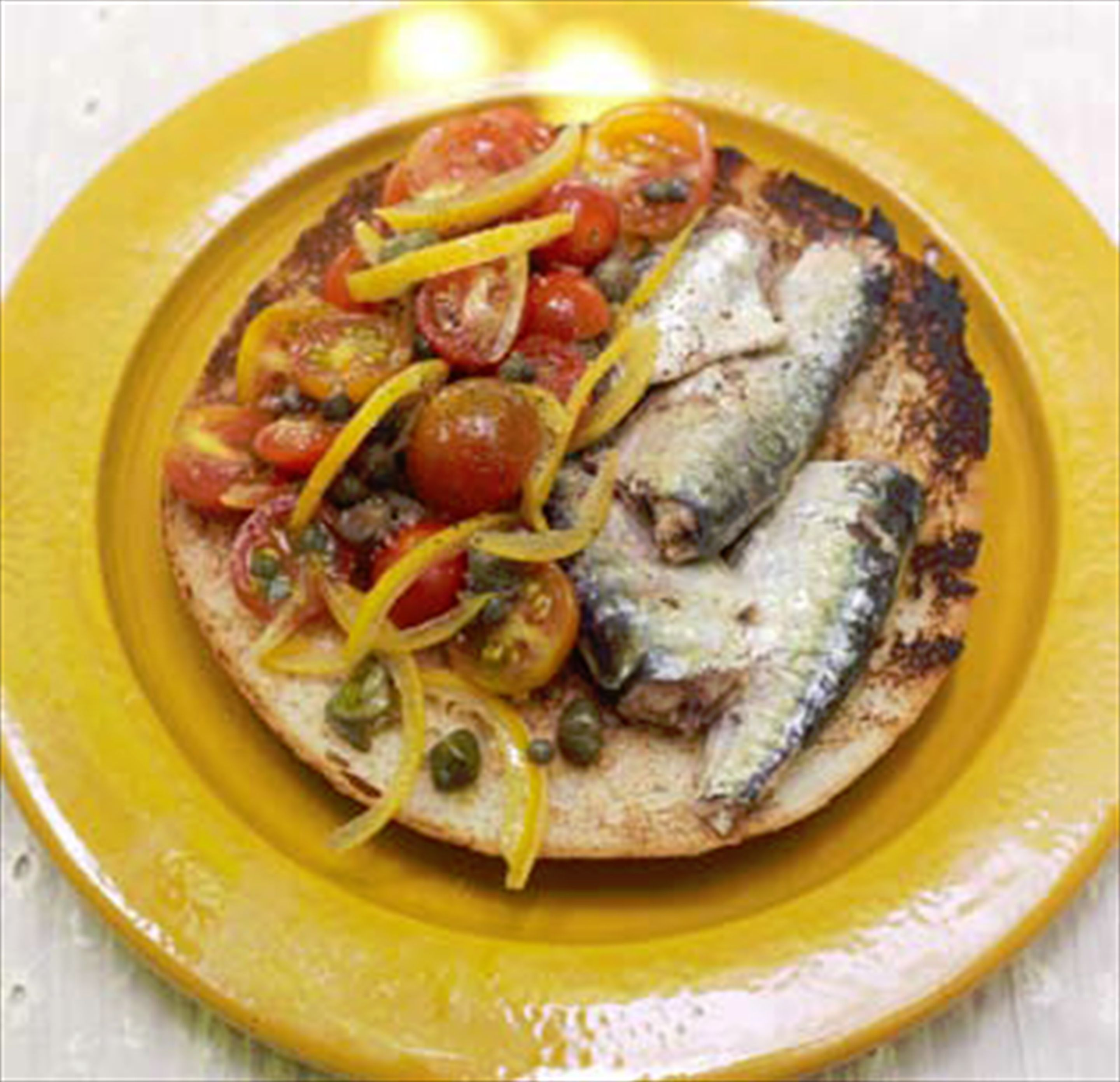 Sardines on toast with cherry tomato & preserved lemon salad